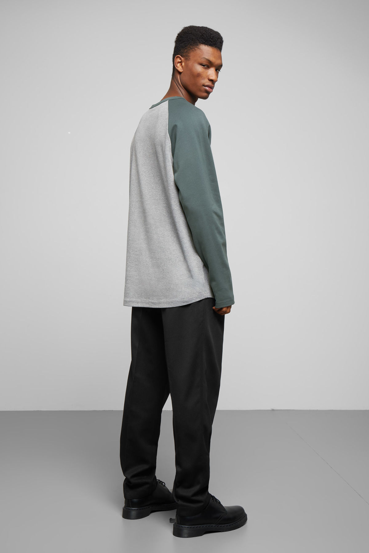 Model side image of Weekday rupert long sleeve in turquoise