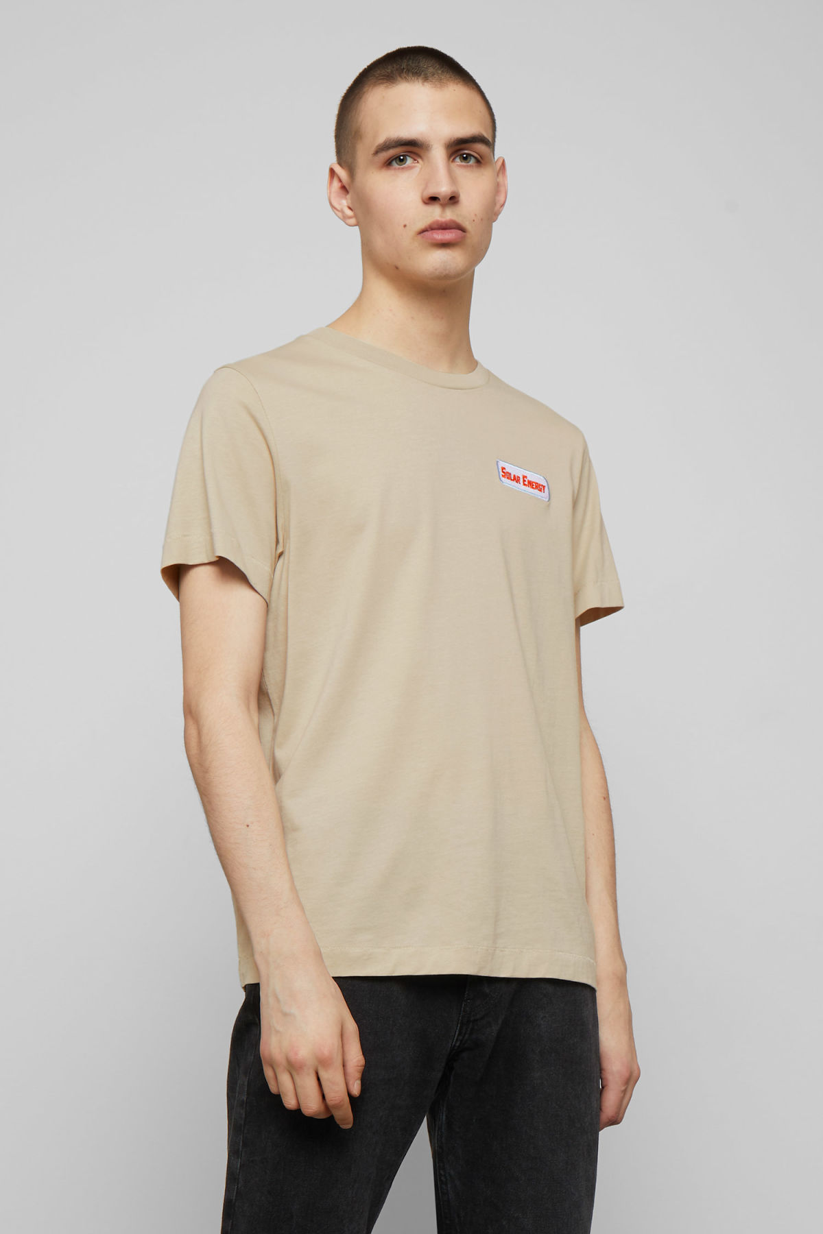 Model front image of Weekday pictor solar t-shirt in beige