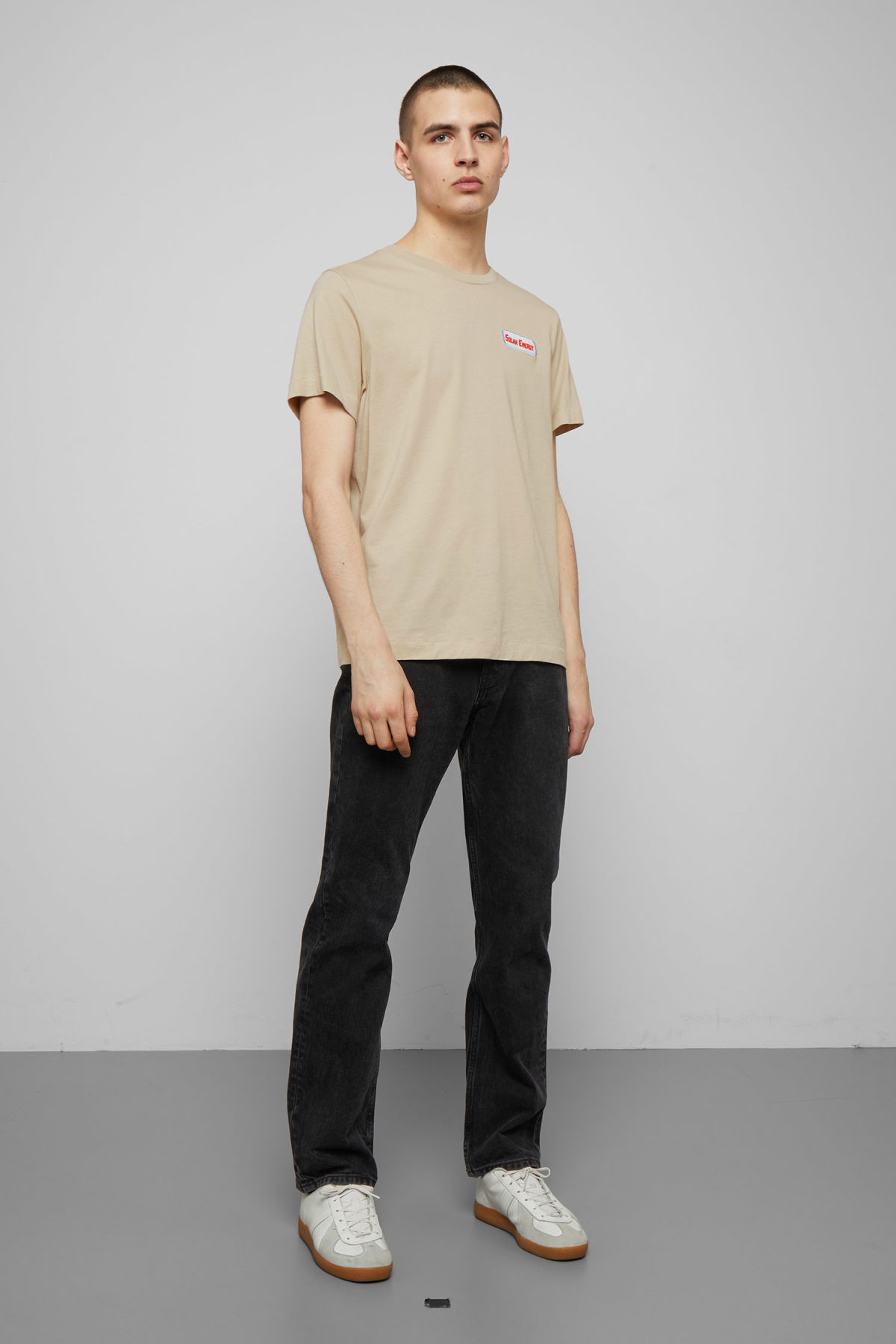 Model side image of Weekday pictor solar t-shirt in beige