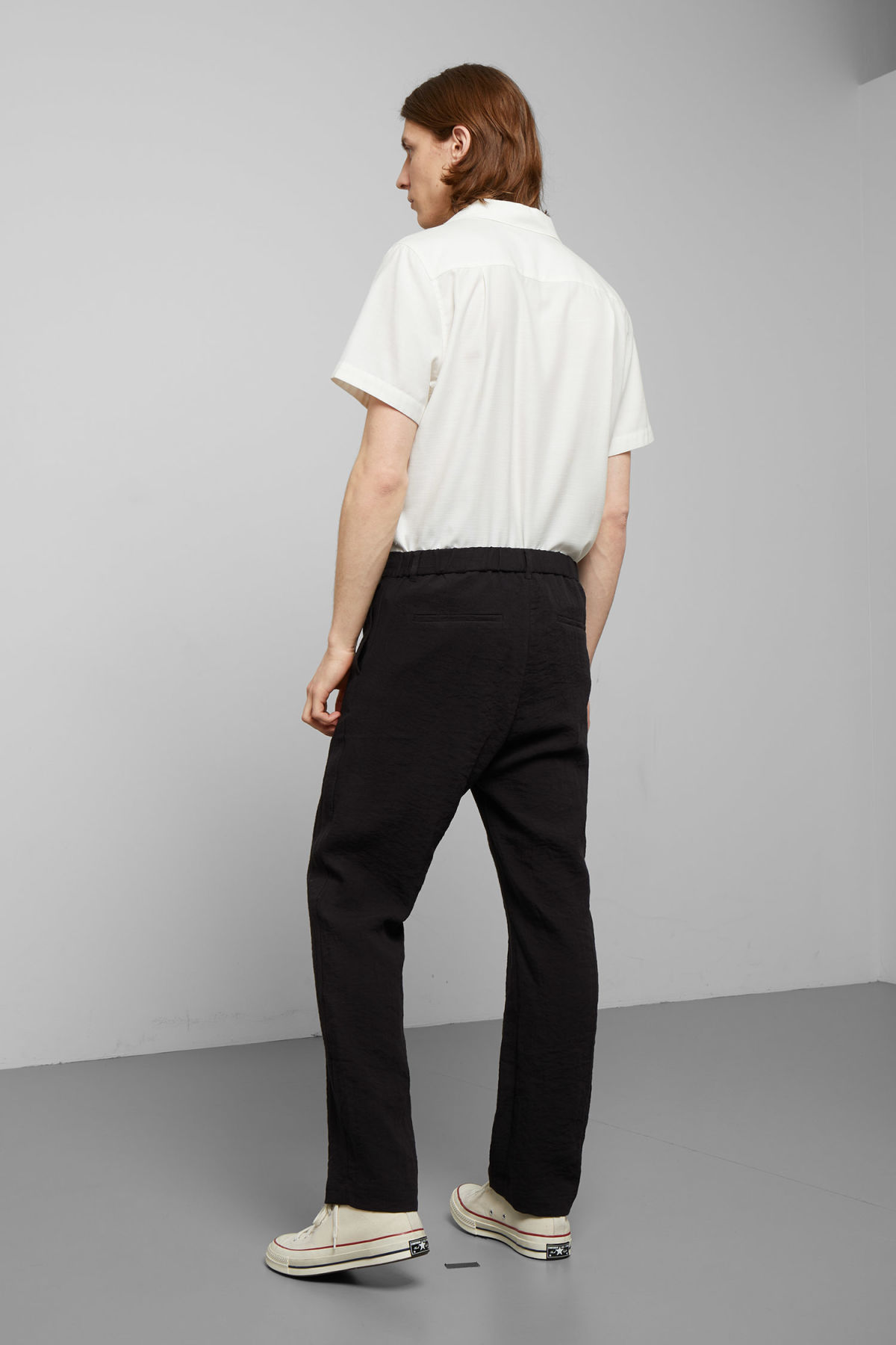 Model back image of Weekday largo trousers in black