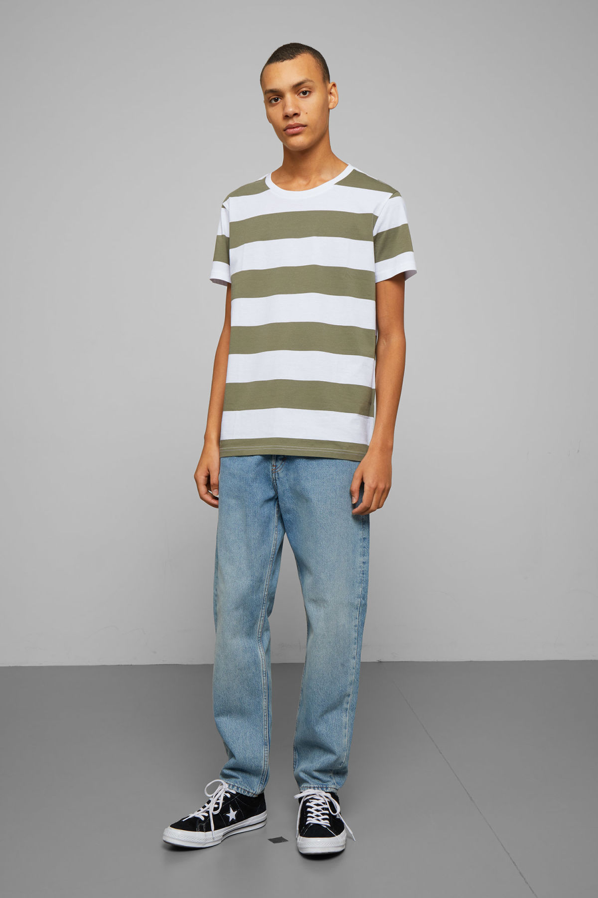 Model side image of Weekday alex stripe t-shirt in green