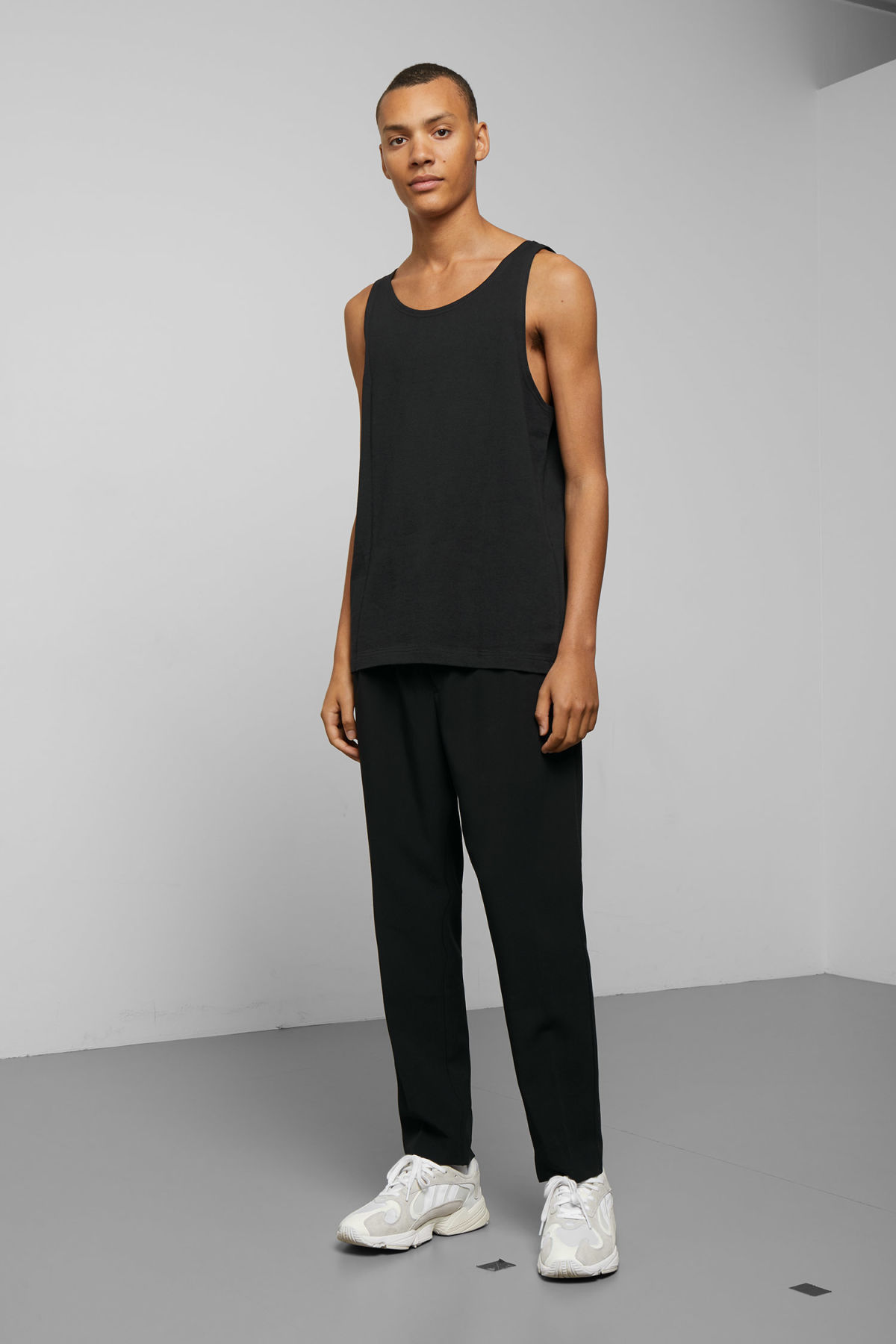 Model side image of Weekday dean tank top in black
