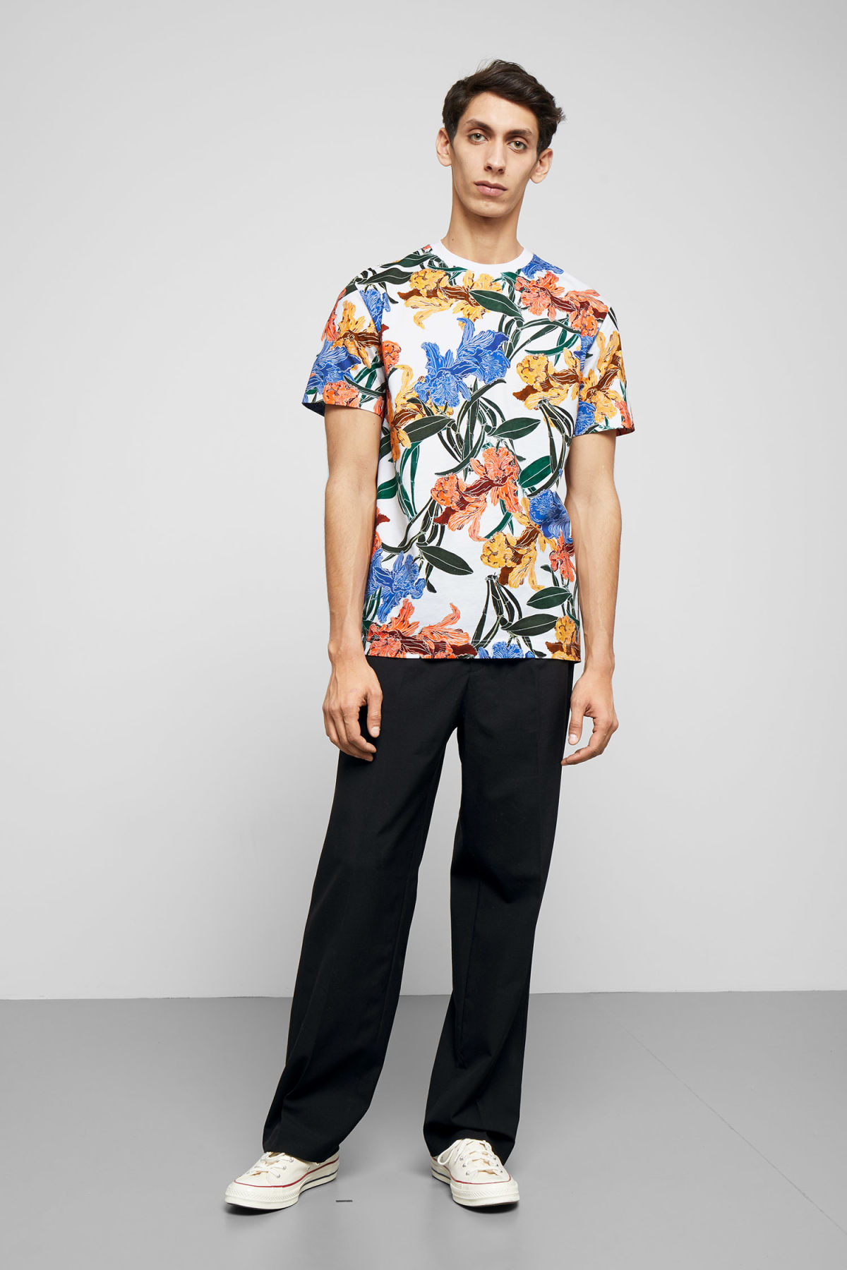Model side image of Weekday billy cattleya garden t-shirt in white