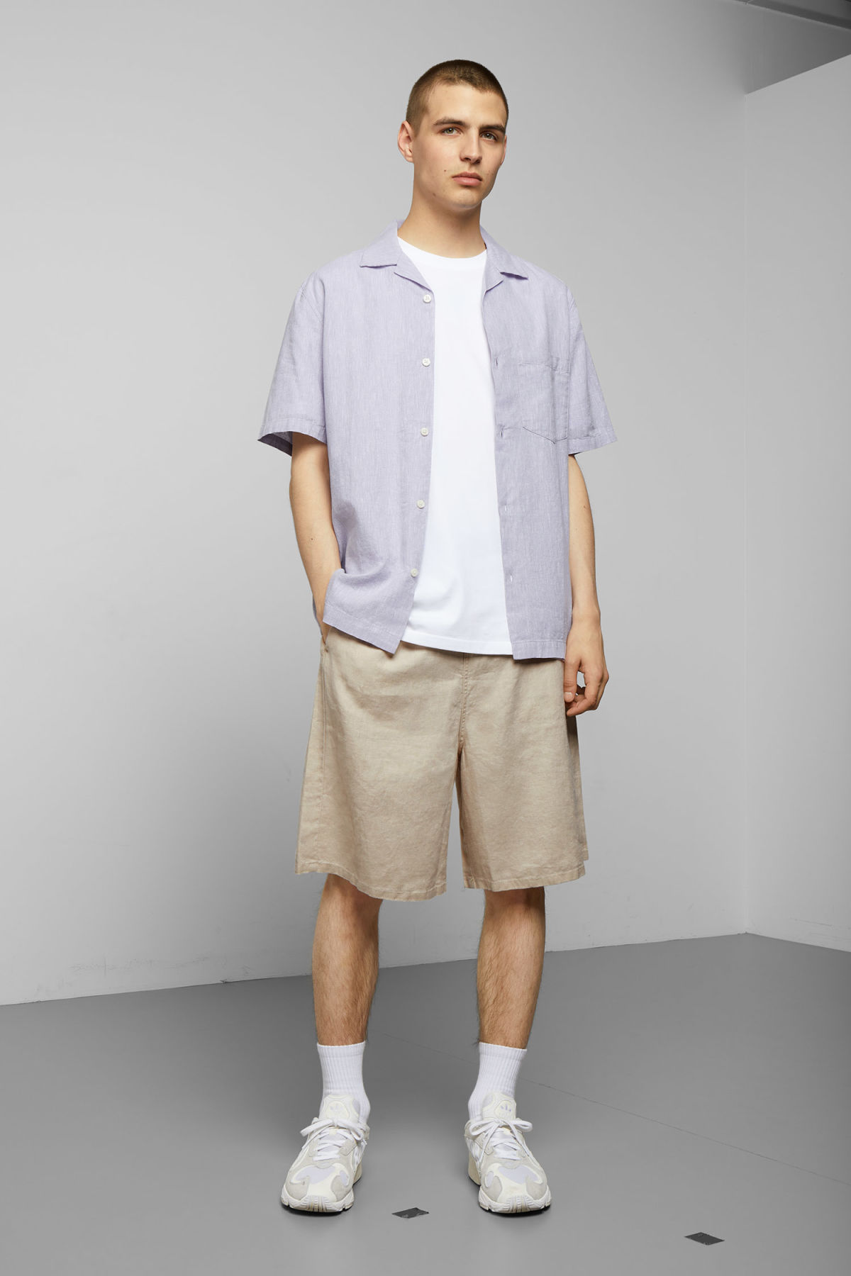 Model side image of Weekday chill striped short sleeve shirt in purple