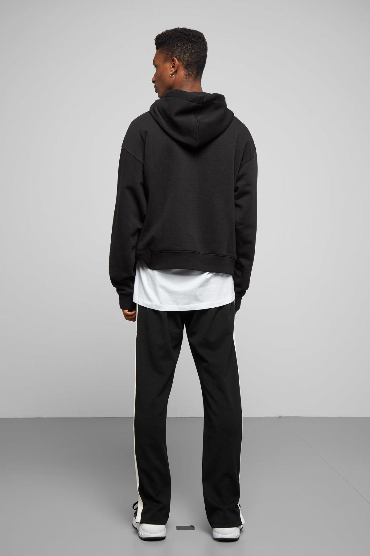 Model side image of Weekday bird hoodie in black