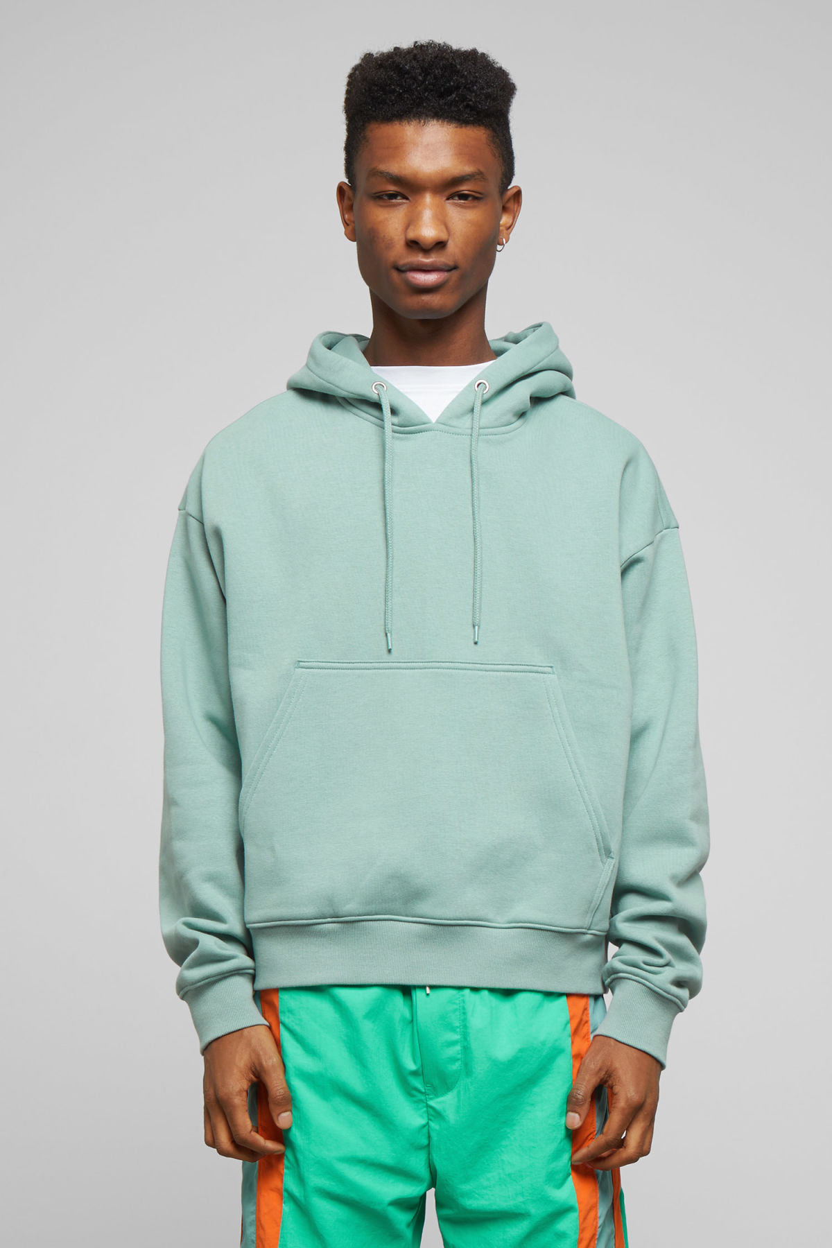 Model front image of Weekday bird hoodie in turquoise