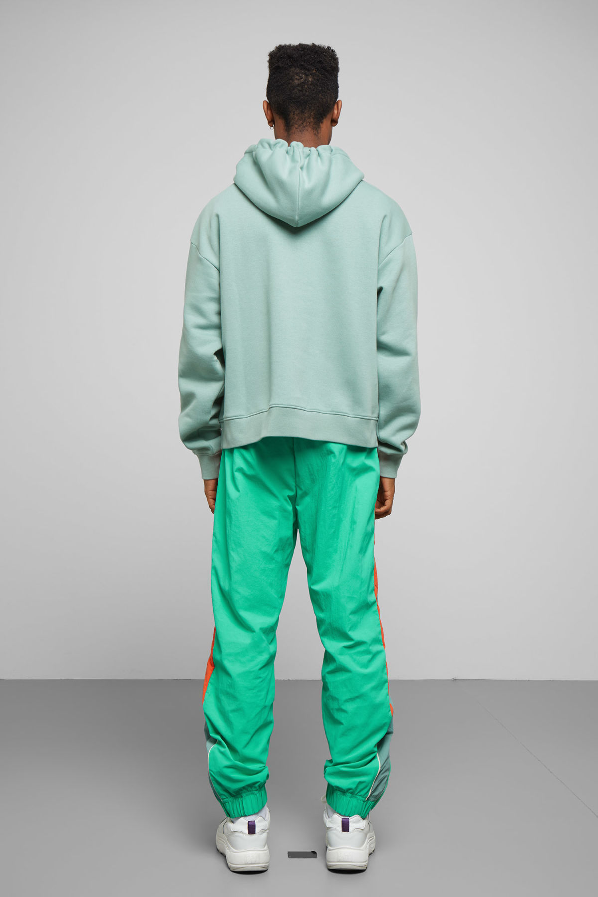 Model side image of Weekday bird hoodie in turquoise