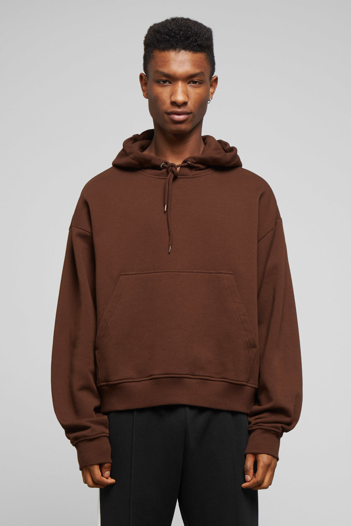 Model front image of Weekday bird hoodie in beige