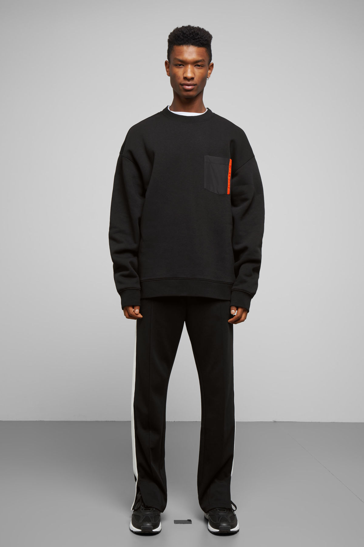 Model side image of Weekday big steve patch sweatshirt in black