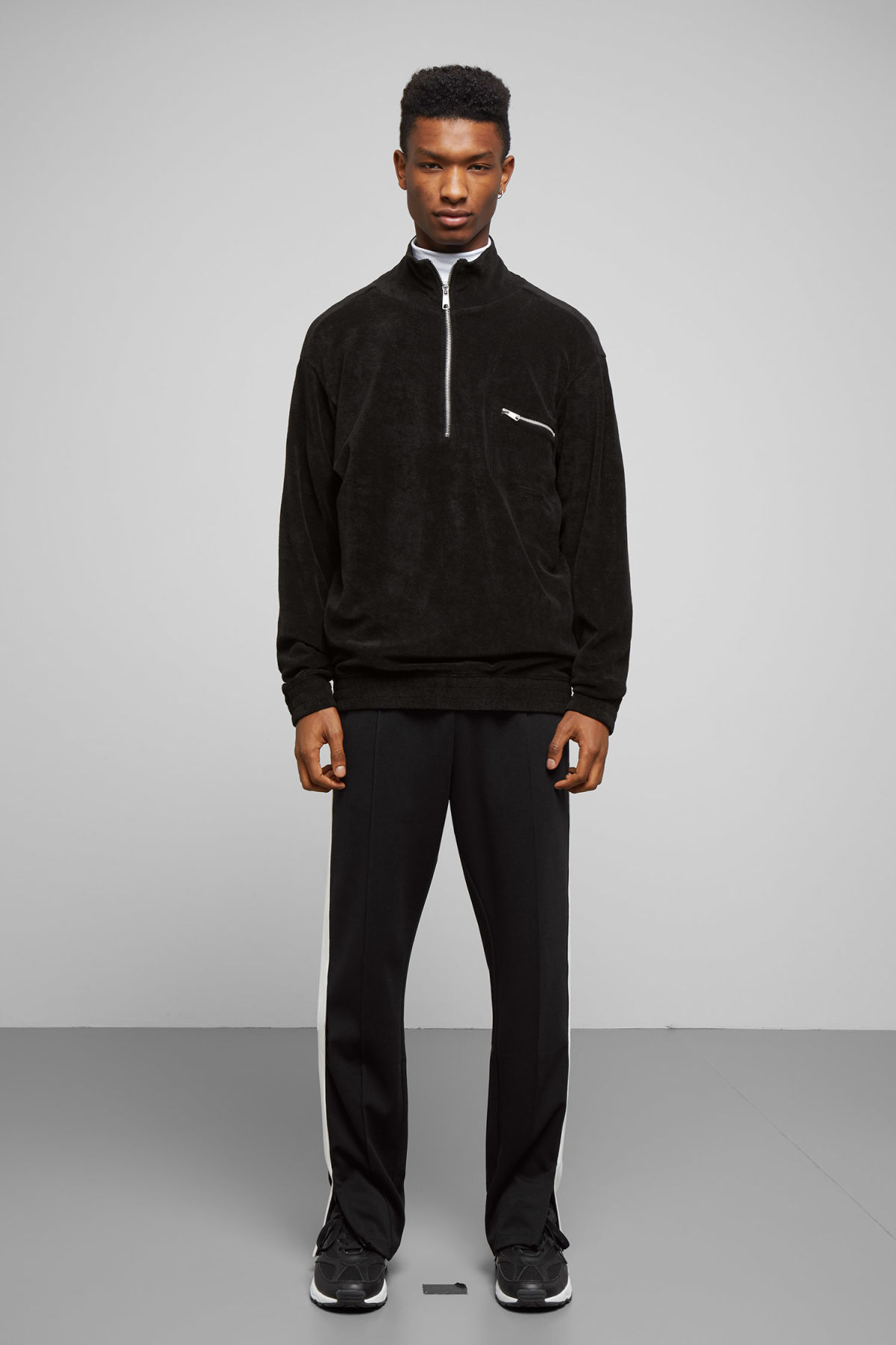 Model side image of Weekday terry halfzip sweatshirt in black