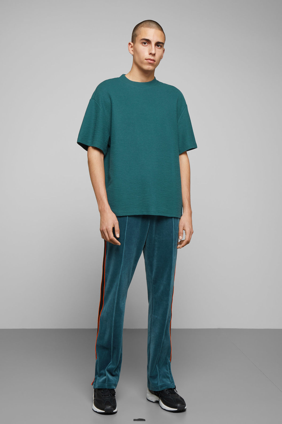 Model side image of Weekday grand t-shirt in turquoise