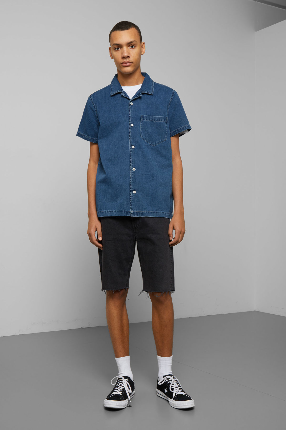 Model side image of Weekday duo porto blue shirt  in blue