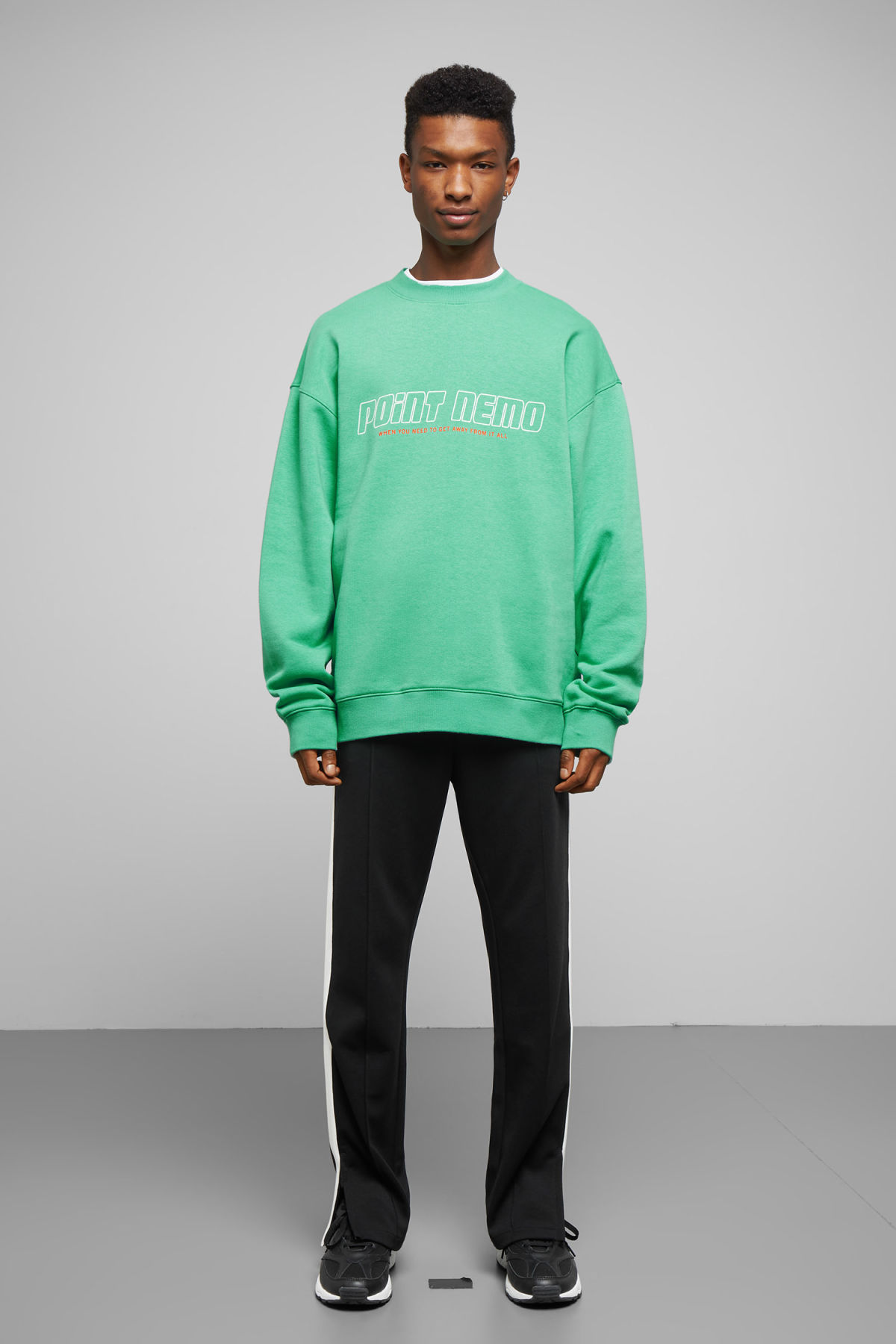 Model side image of Weekday big steve nemo sweatshirt in green