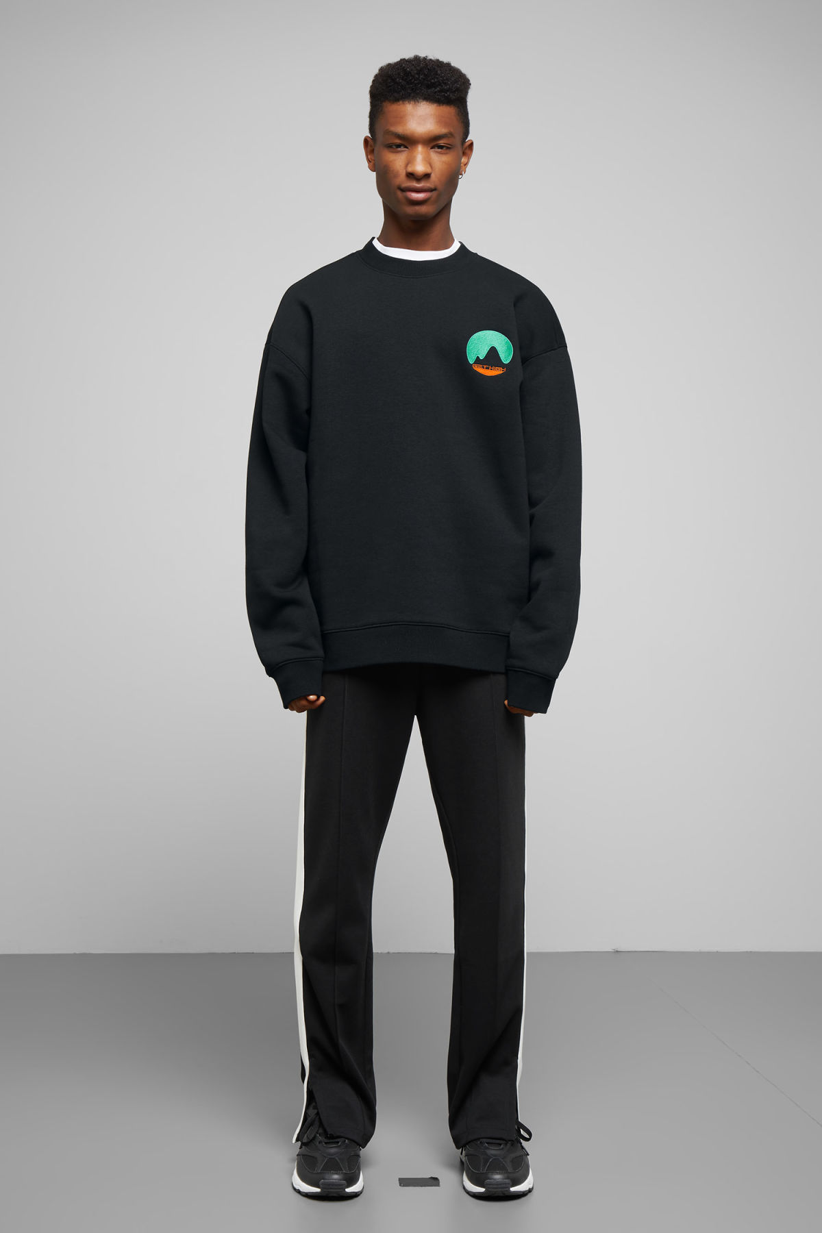 Model side image of Weekday big steve get high sweatshirt in black