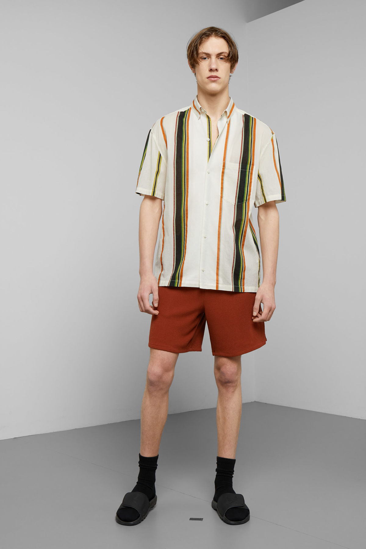 Model side image of Weekday mack stripe shirt in white
