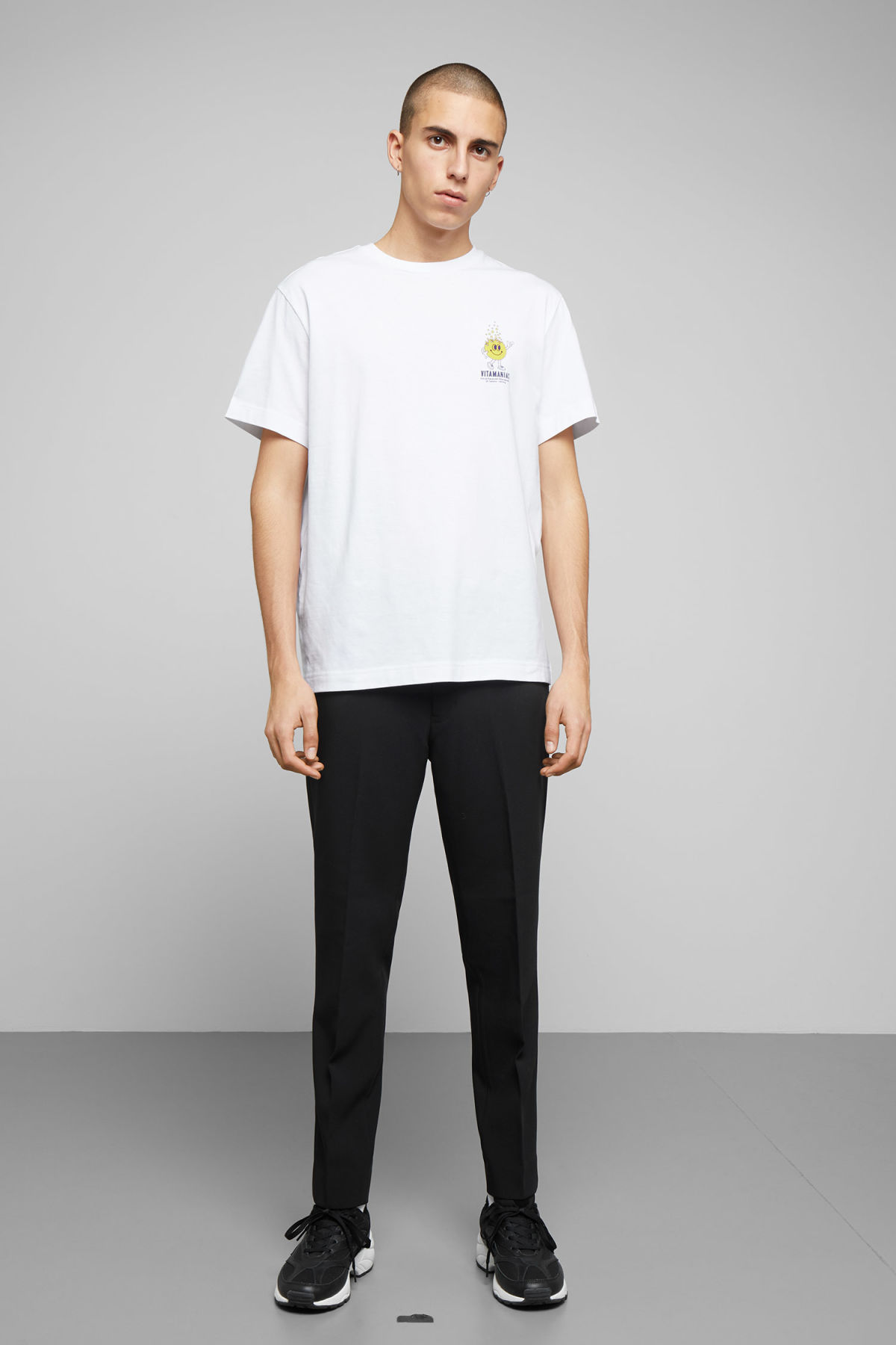 Model side image of Weekday billy vitamin c t-shirt  in white
