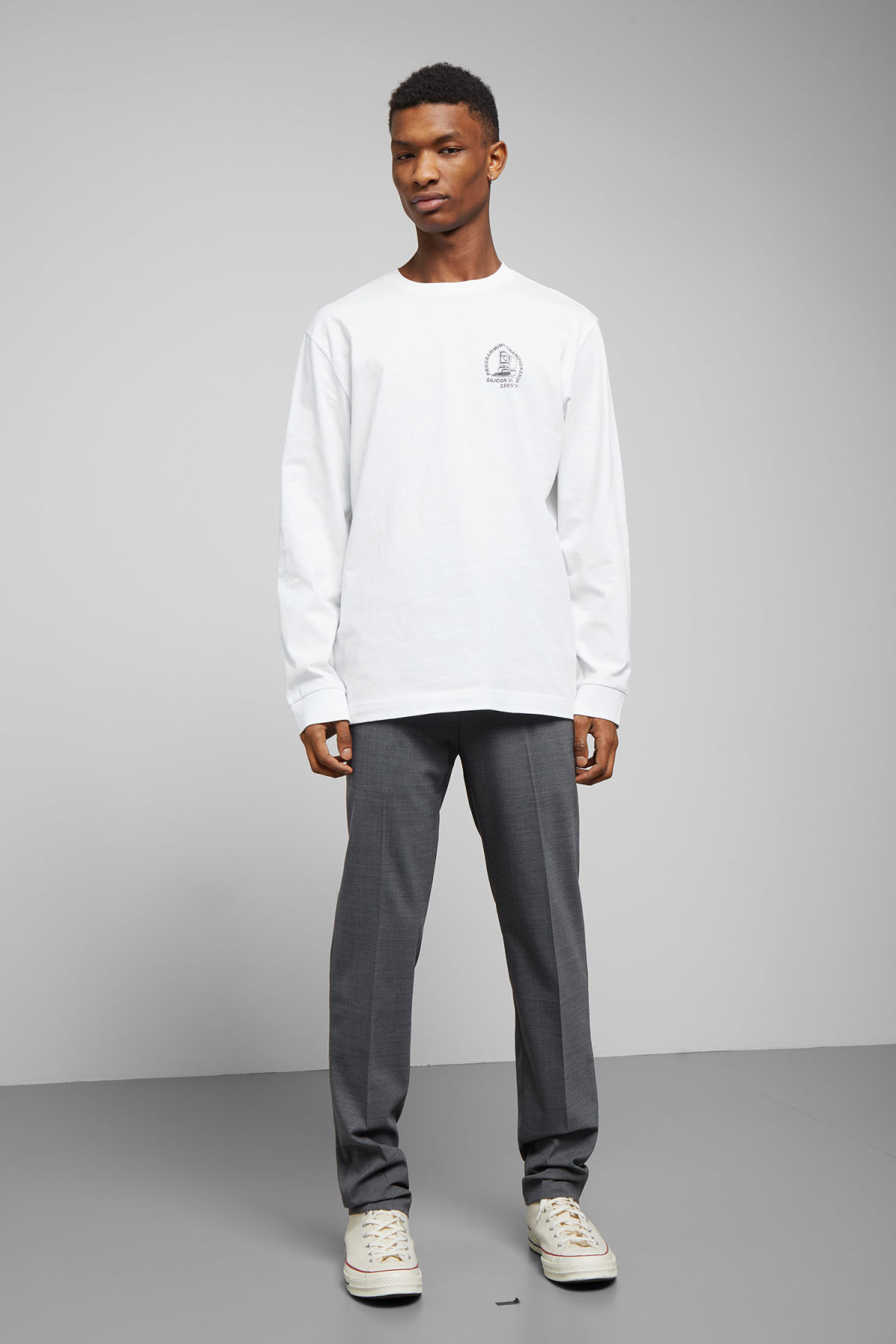 Model side image of Weekday carlos programming long sleeve in white