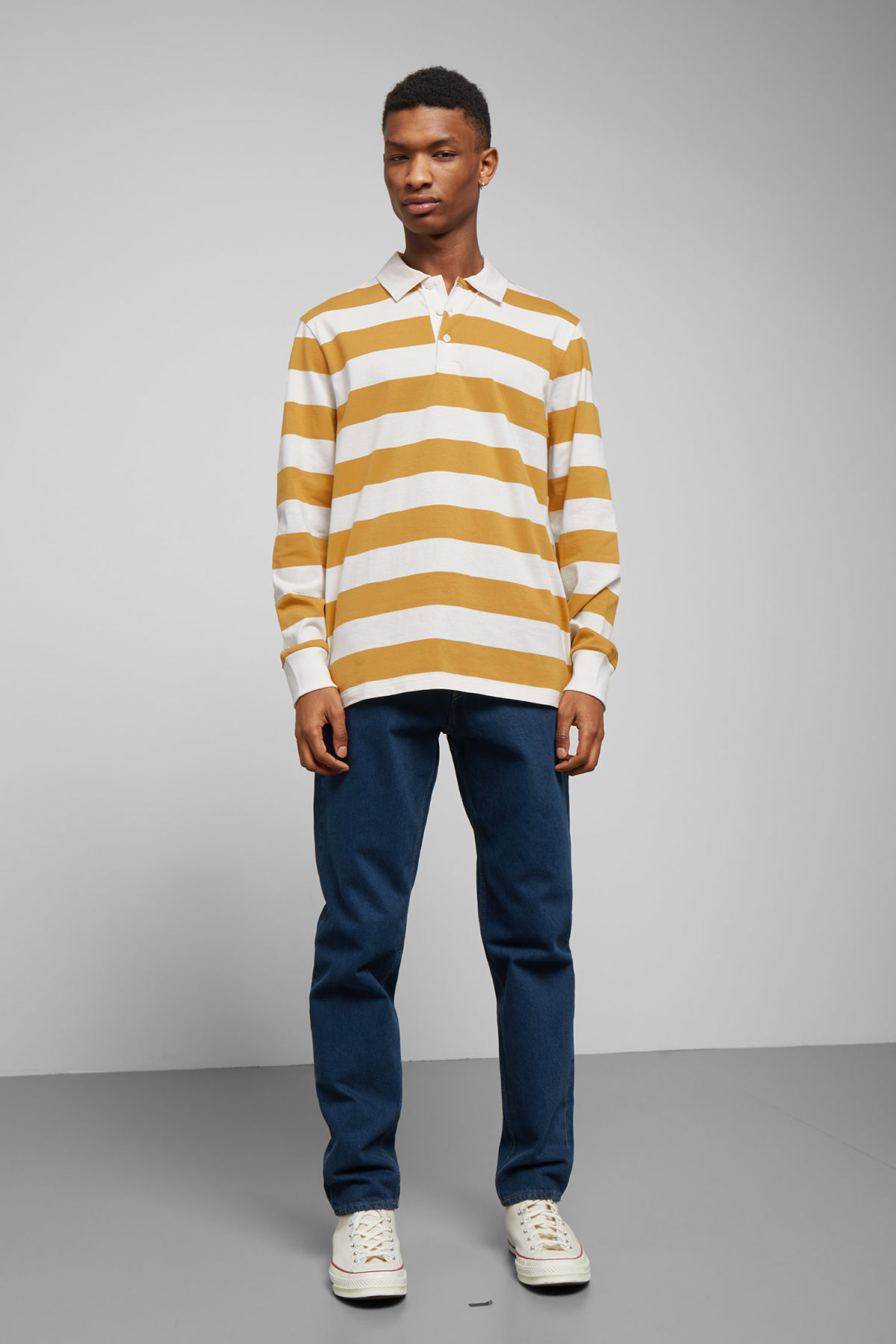 Model side image of Weekday elmer striped polo in yellow