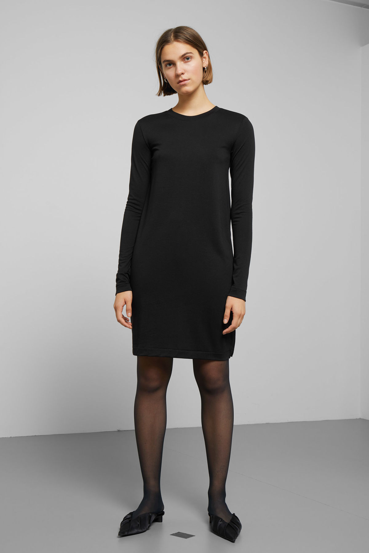 Model front image of Weekday beyond long sleeve dress  in black