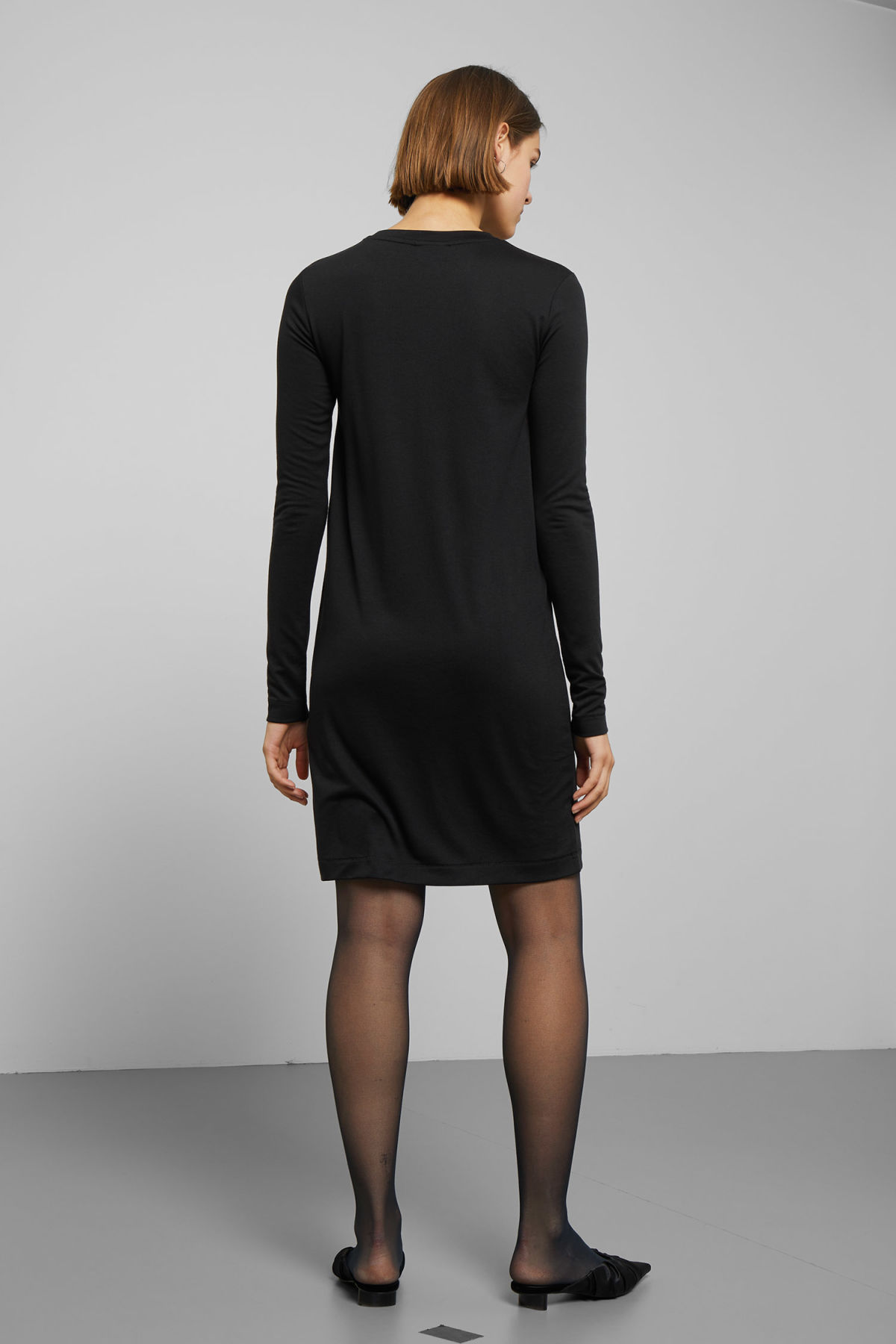 Model back image of Weekday beyond long sleeve dress  in black