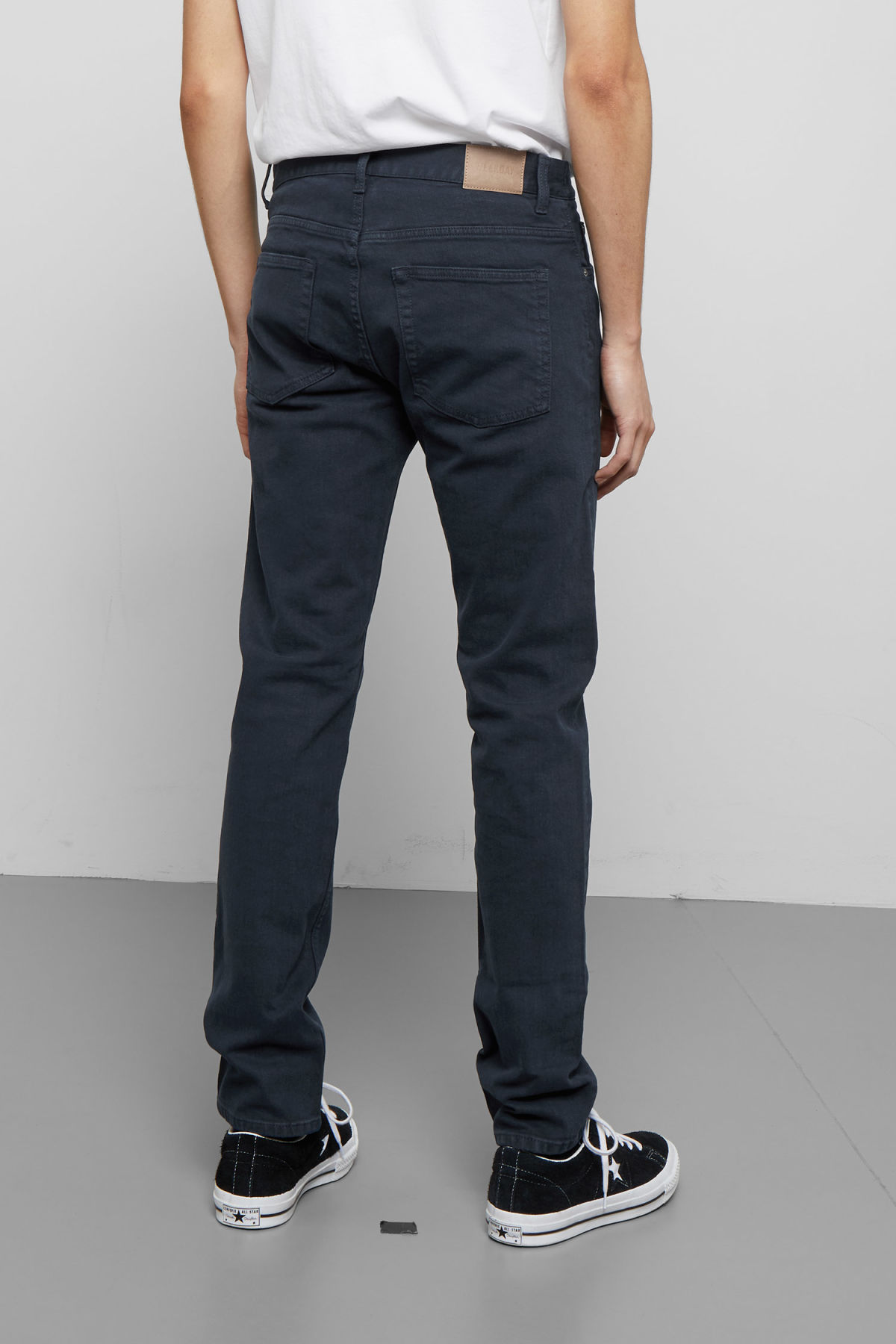 Model side image of Weekday friday navy jeans in blue