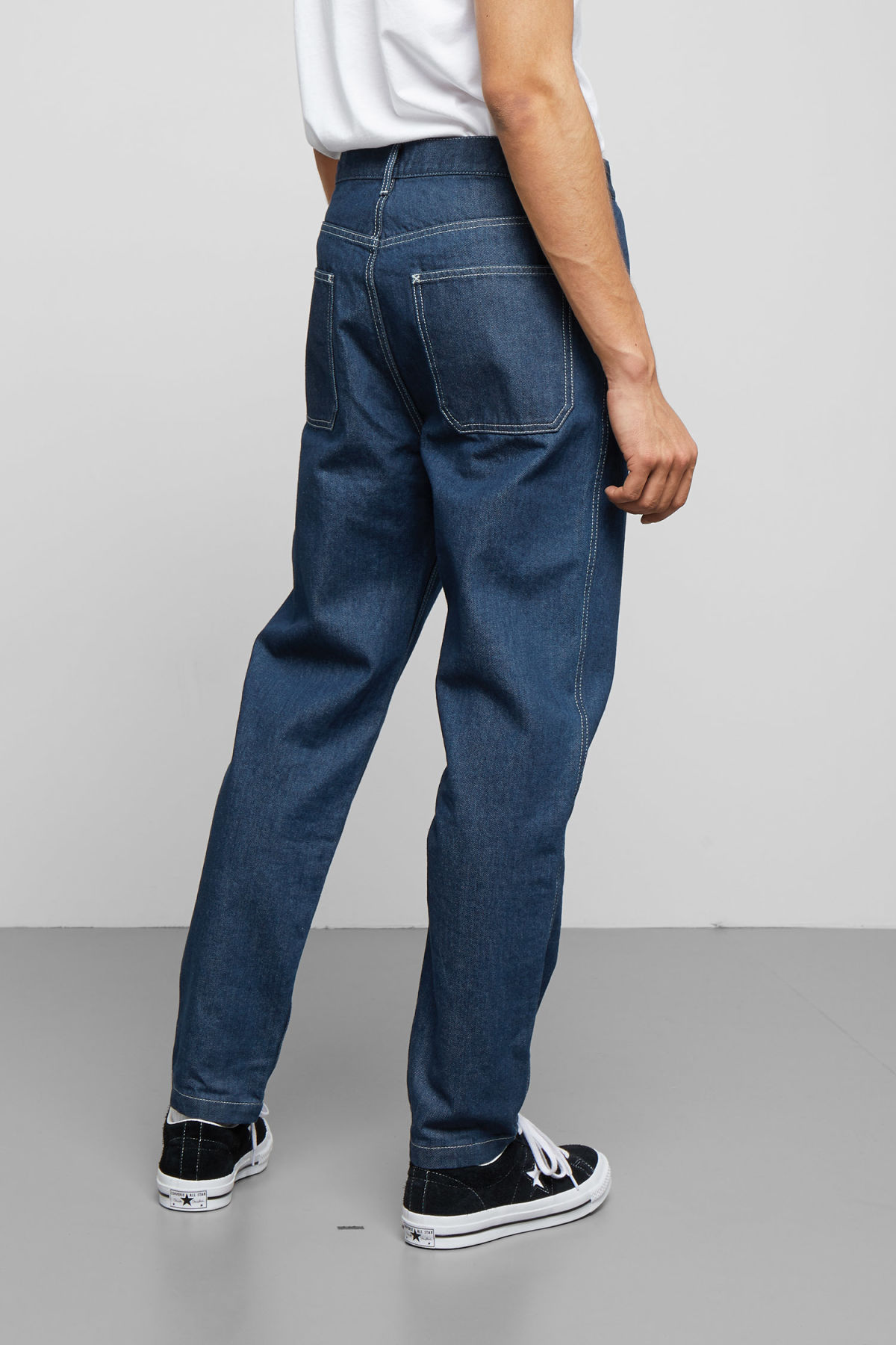 Model side image of Weekday sack rinse jeans in blue