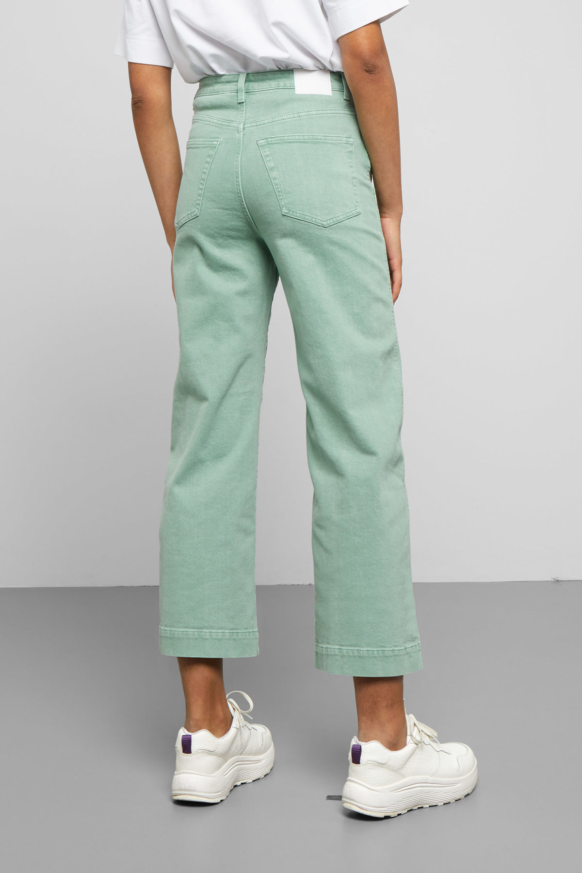 Model side image of Weekday veer sage jeans in green