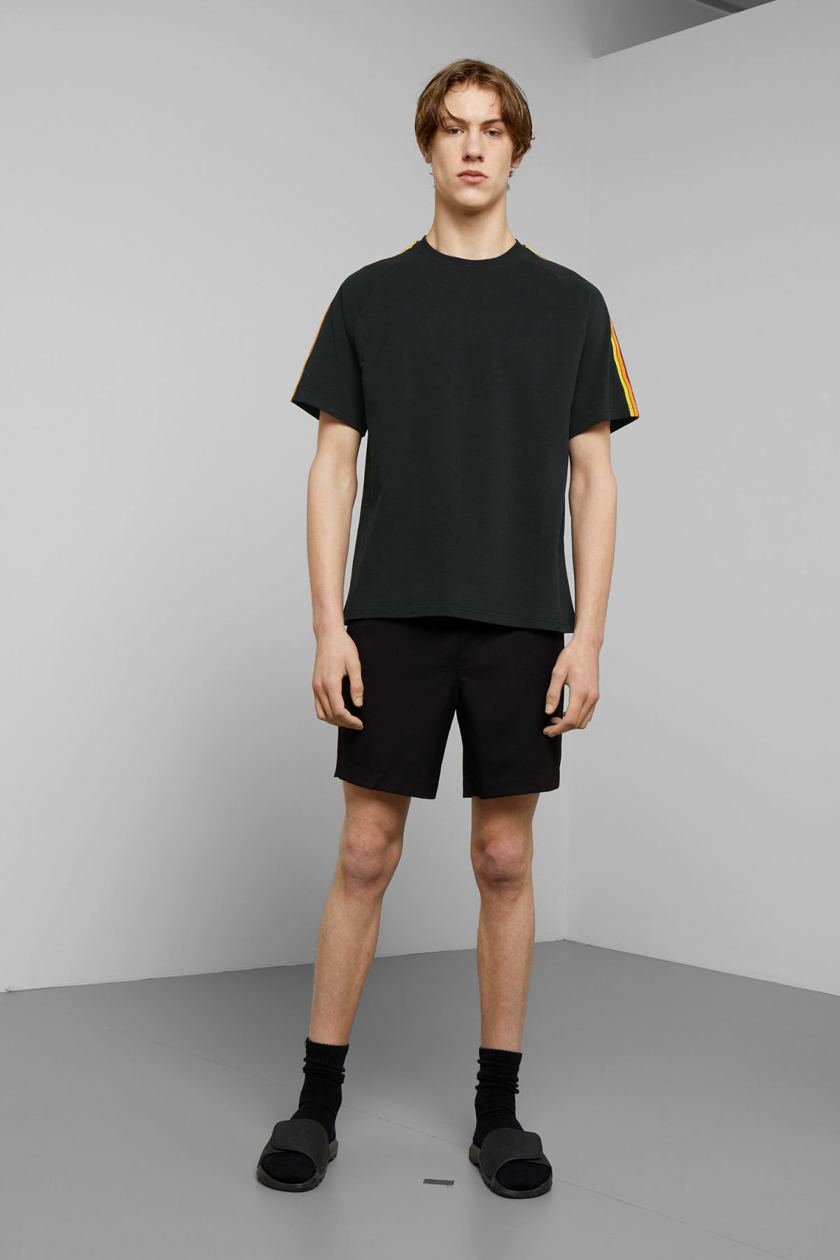 Model side image of Weekday rodger t-shirt in black