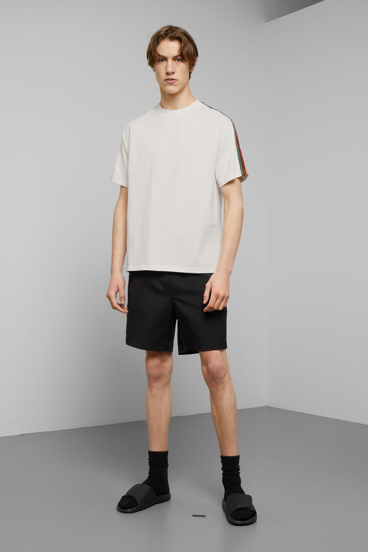 Model side image of Weekday rodger t-shirt in white