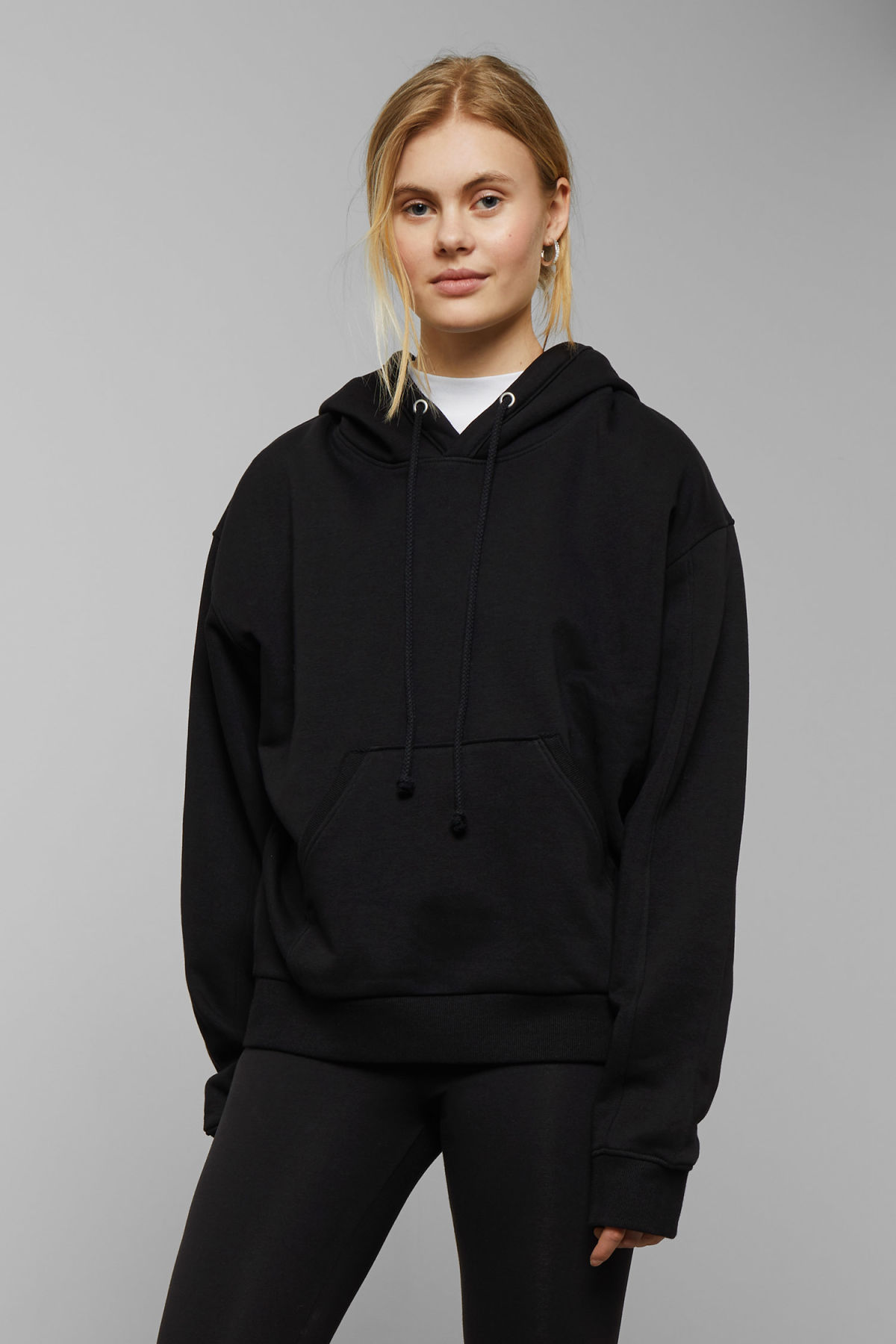 Model front image of Weekday ailin hooded sweatshirt in black