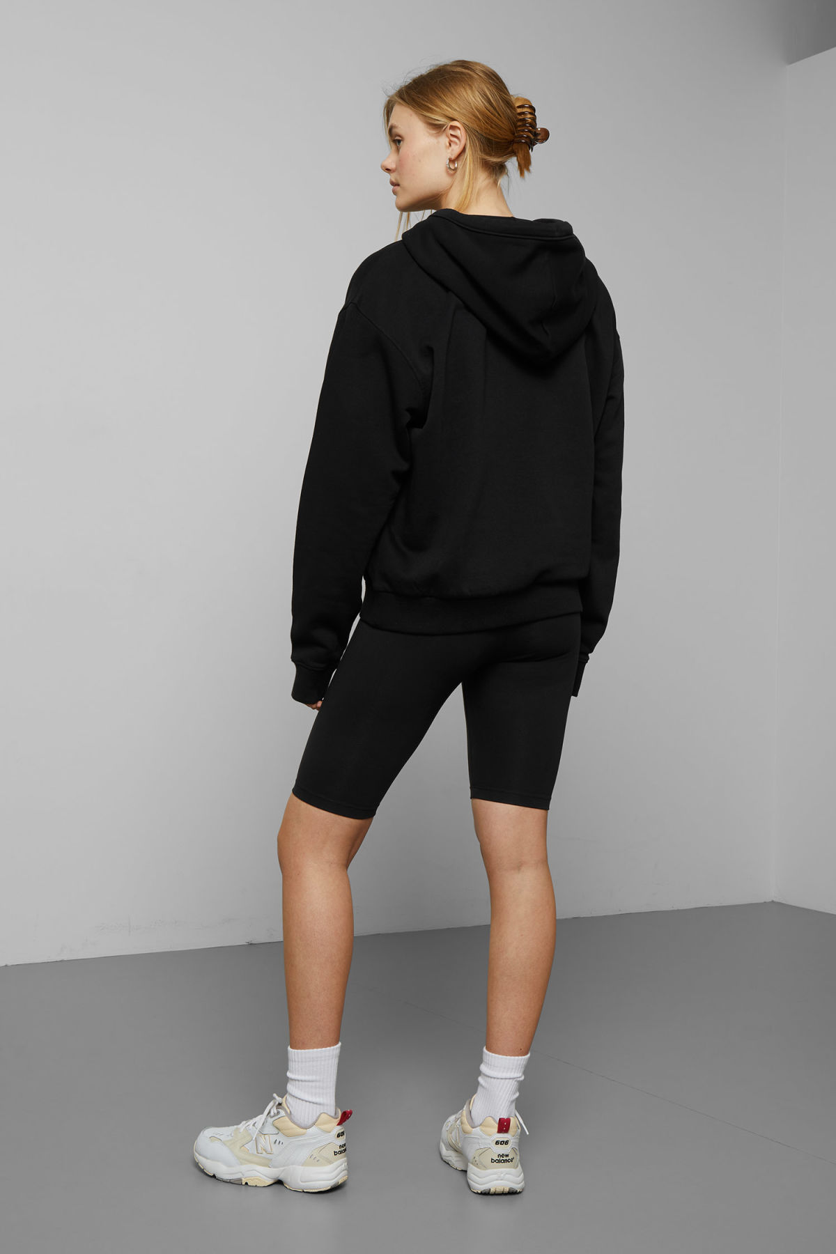 Model back image of Weekday ailin hooded sweatshirt in black