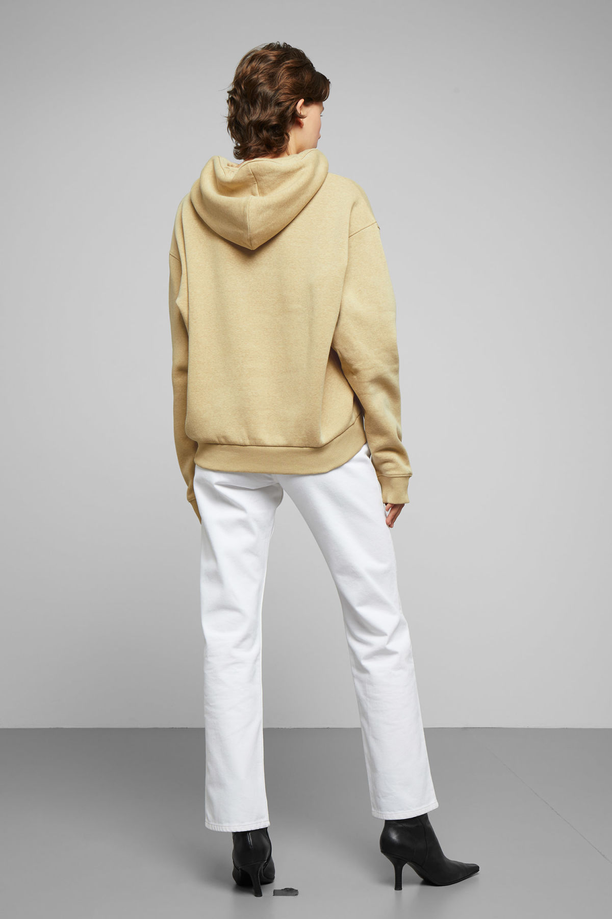 Model back image of Weekday ailin hooded sweatshirt in beige