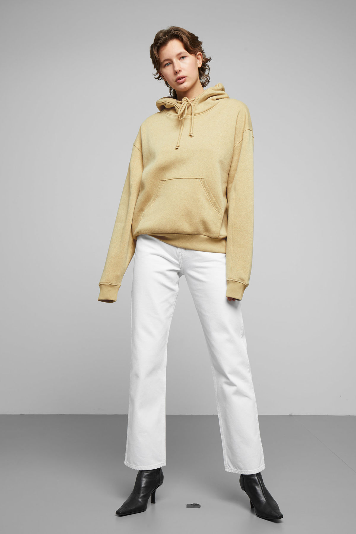Model side image of Weekday ailin hooded sweatshirt in beige