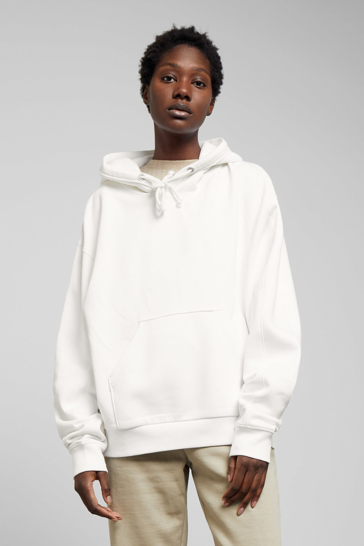 Model front image of Weekday ailin hooded sweatshirt in white