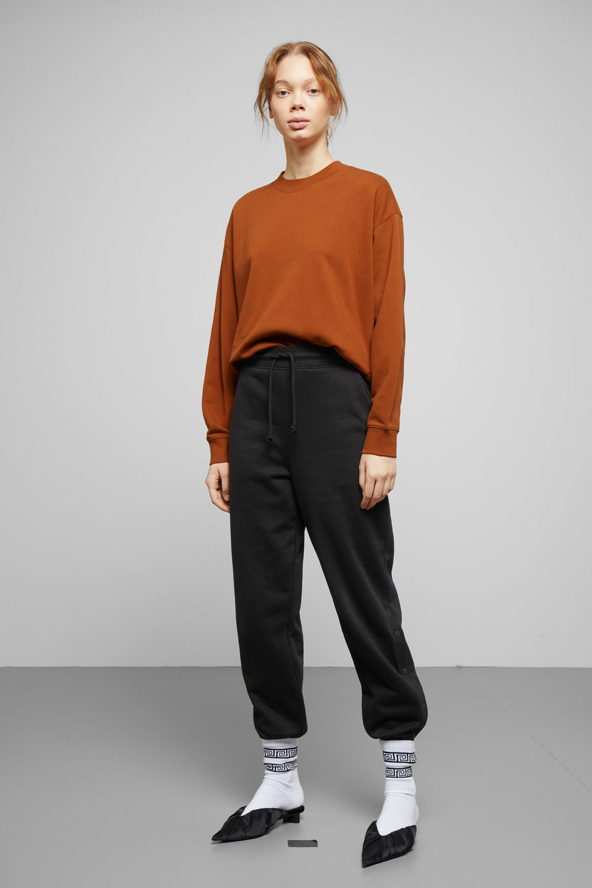 Model side image of Weekday huge cropped sweatshirt  in orange