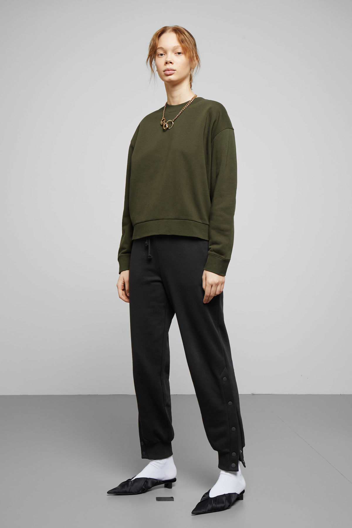 Model side image of Weekday huge cropped sweatshirt  in green