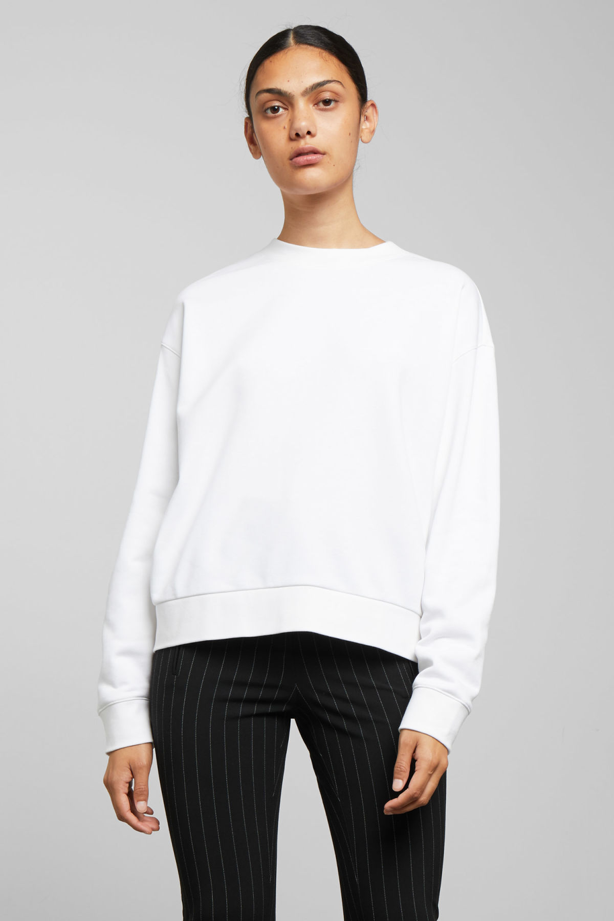 Model front image of Weekday huge cropped sweatshirt  in white