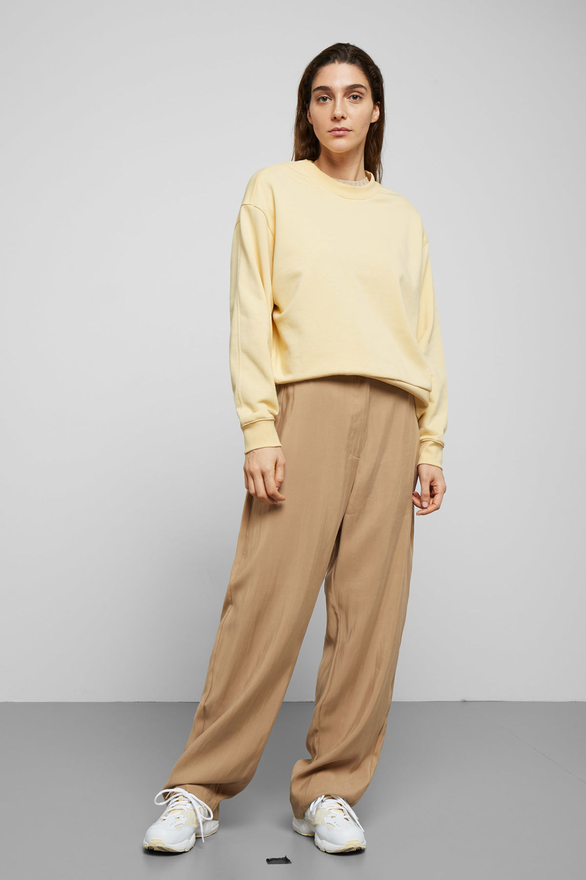 Model side image of Weekday huge cropped sweatshirt  in yellow