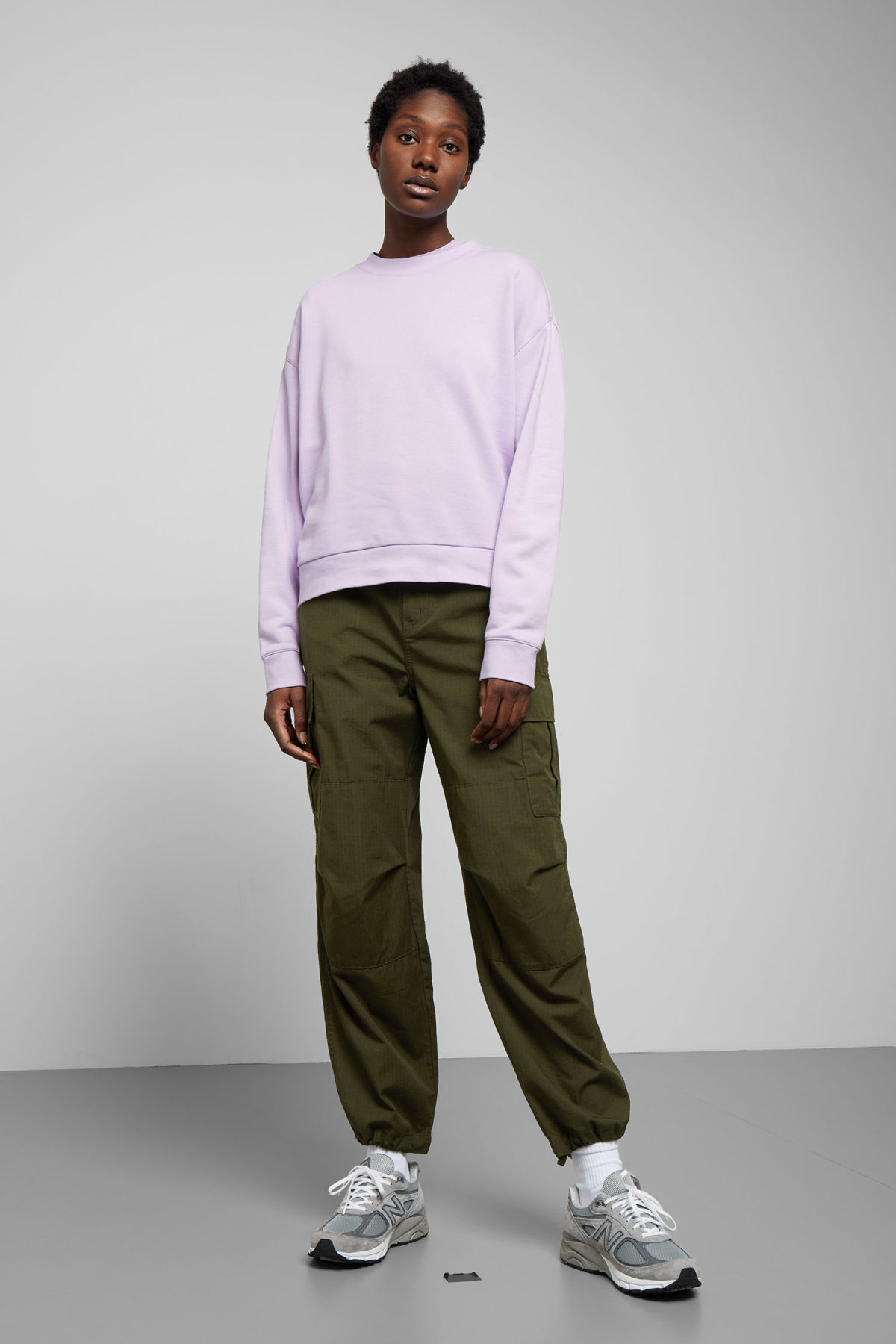 Model side image of Weekday huge cropped sweatshirt  in purple