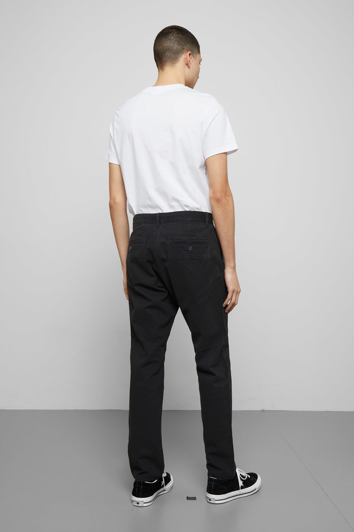 Model back image of Weekday kaj chinos in black