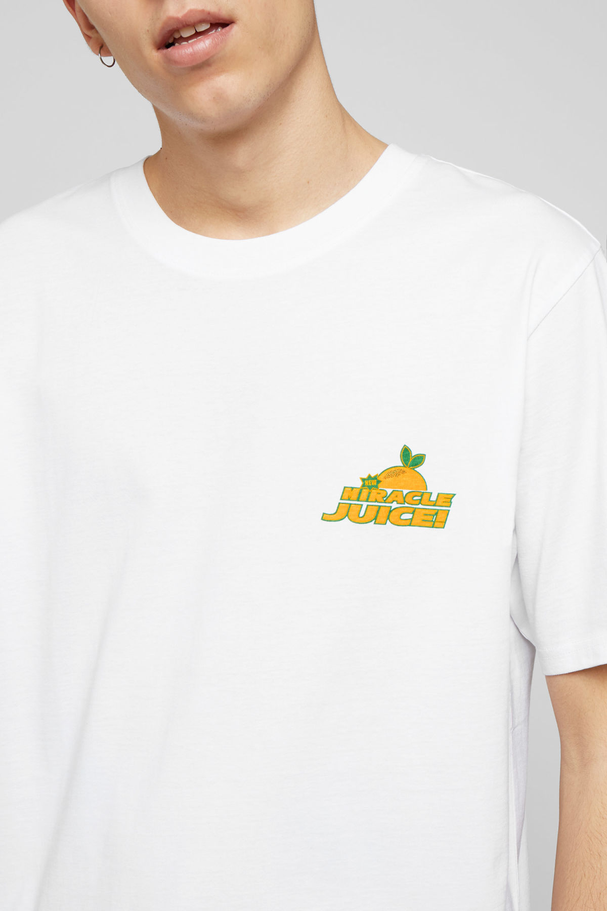 Model side image of Weekday frank miracle juice t-shirt in white