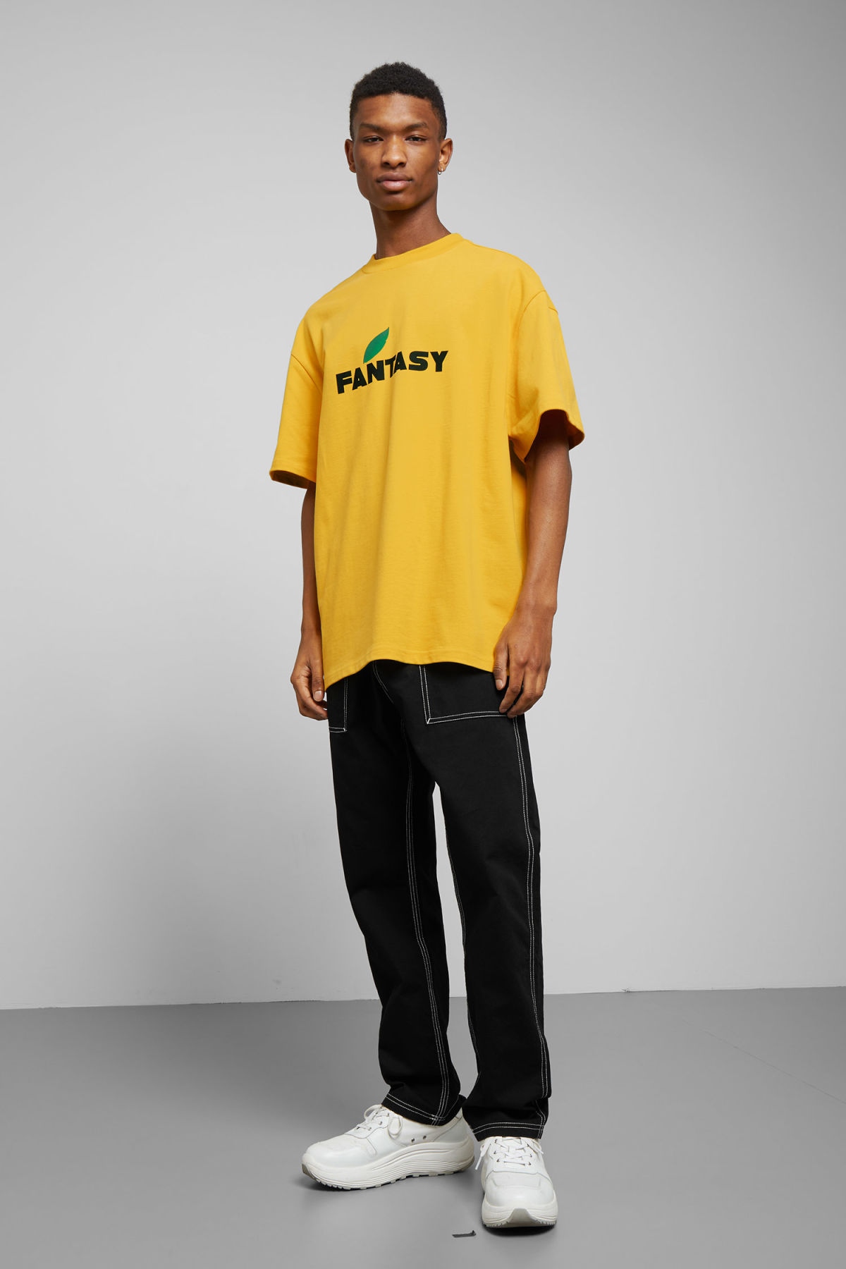 Model side image of Weekday great fantasy t-shirt in yellow