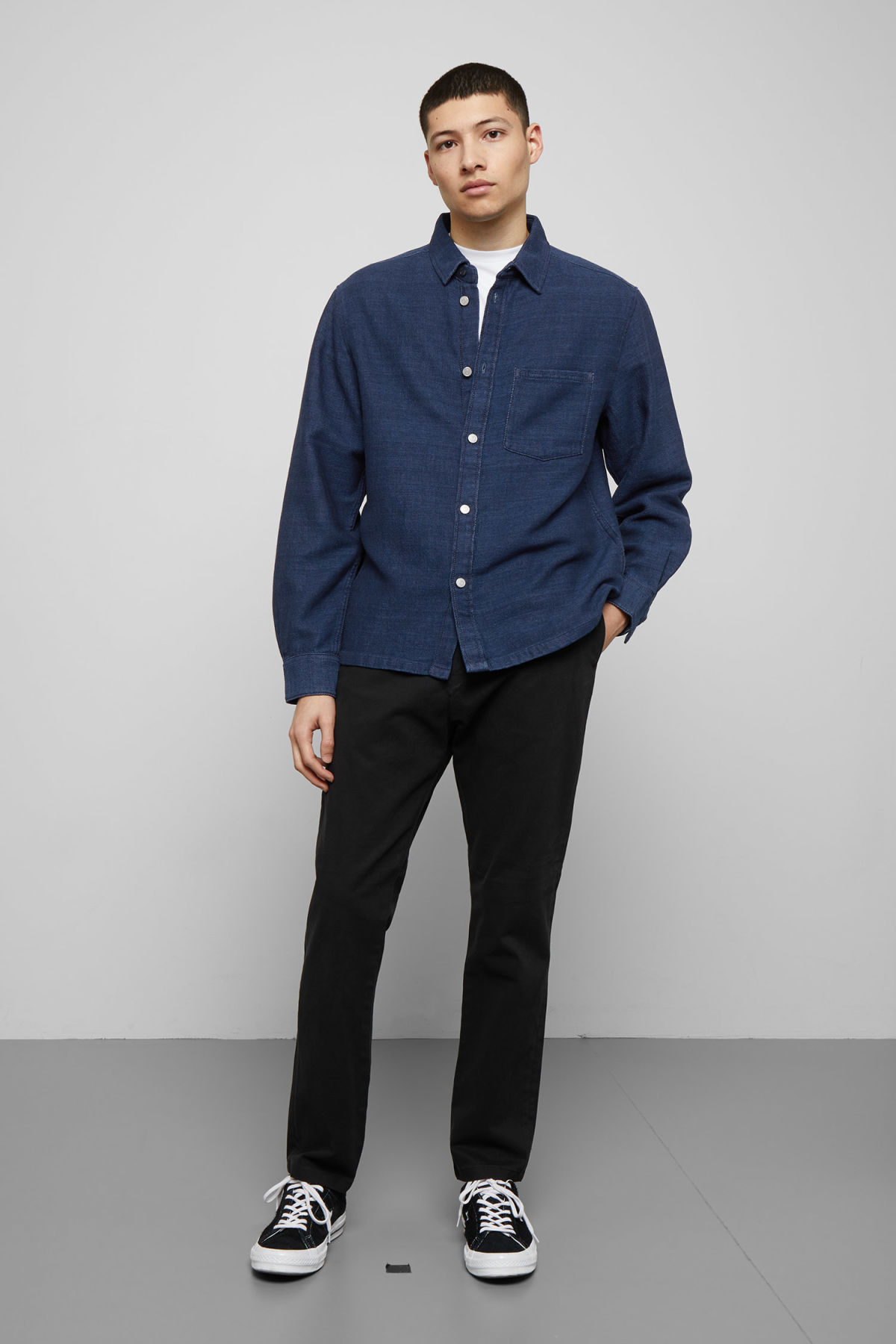 Model side image of Weekday wise wavy blue denim shirt  in blue