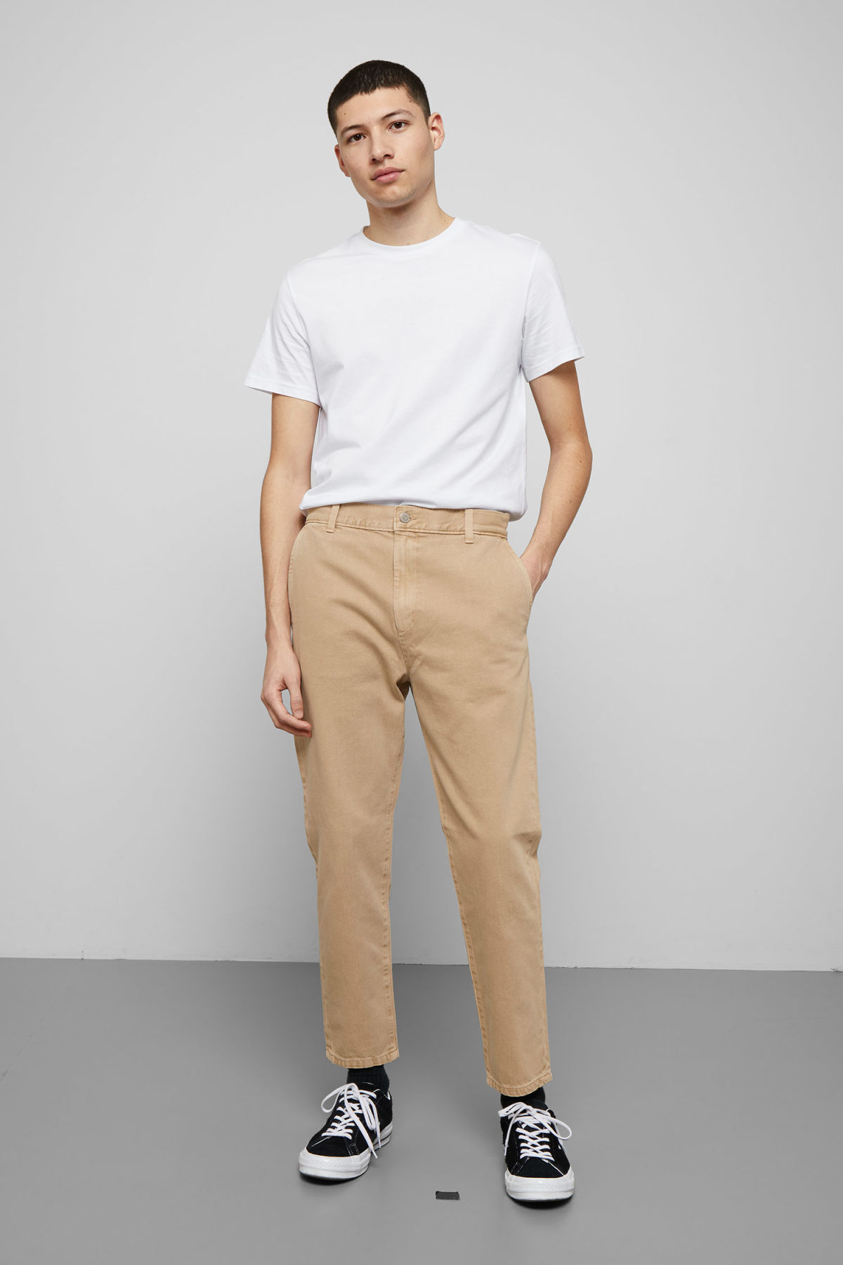 Model front image of Weekday arbus sand denim chinos in beige