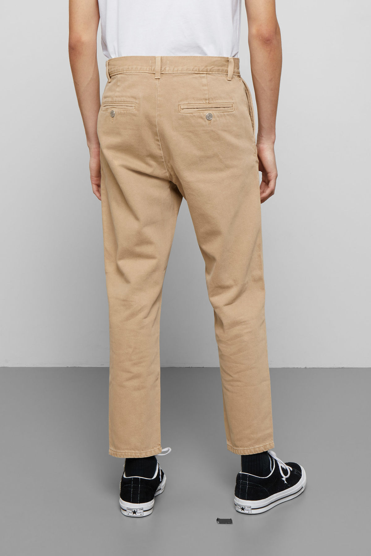 Model side image of Weekday arbus sand denim chinos in beige