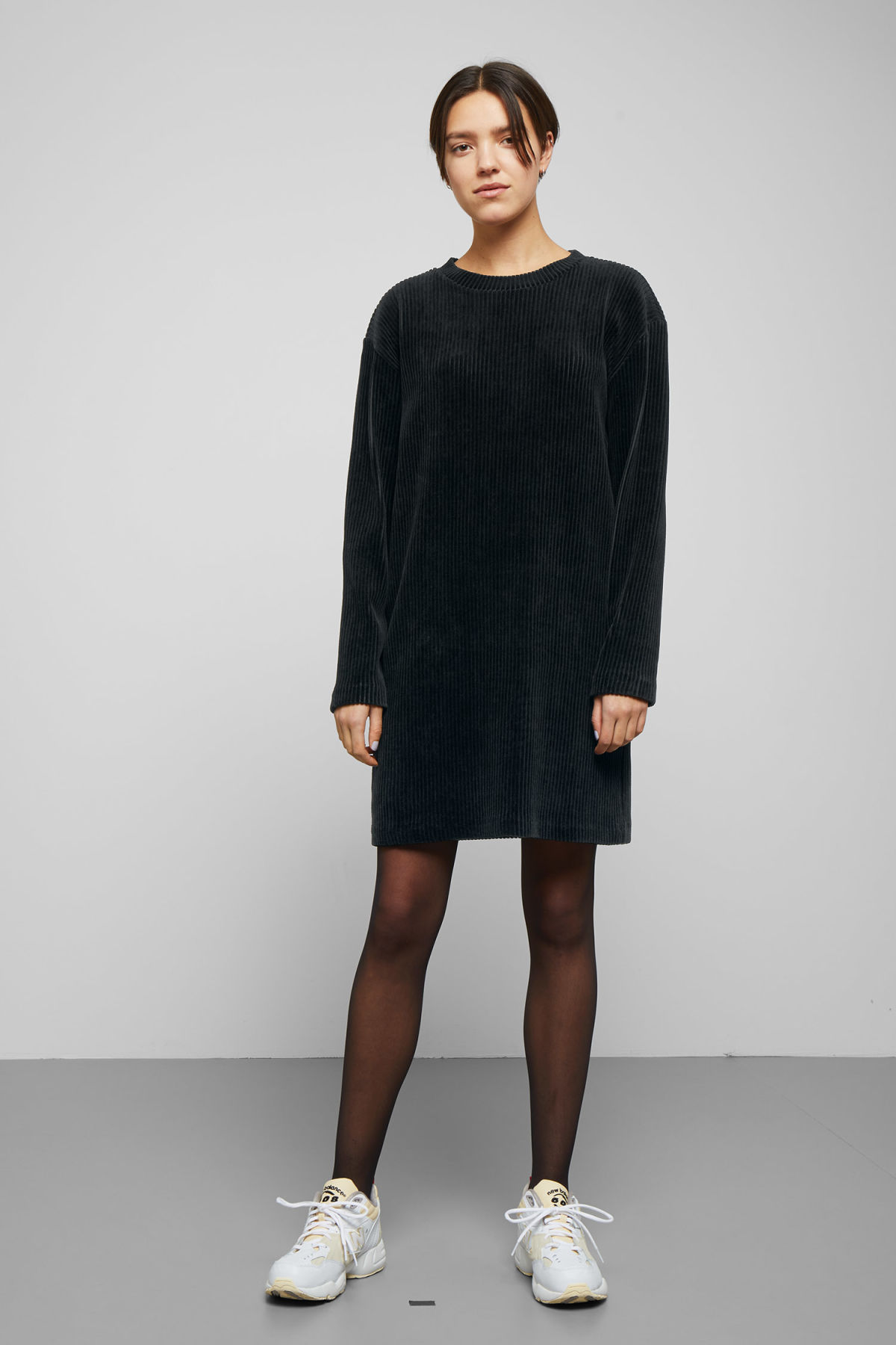 Model side image of Weekday elina dress in black