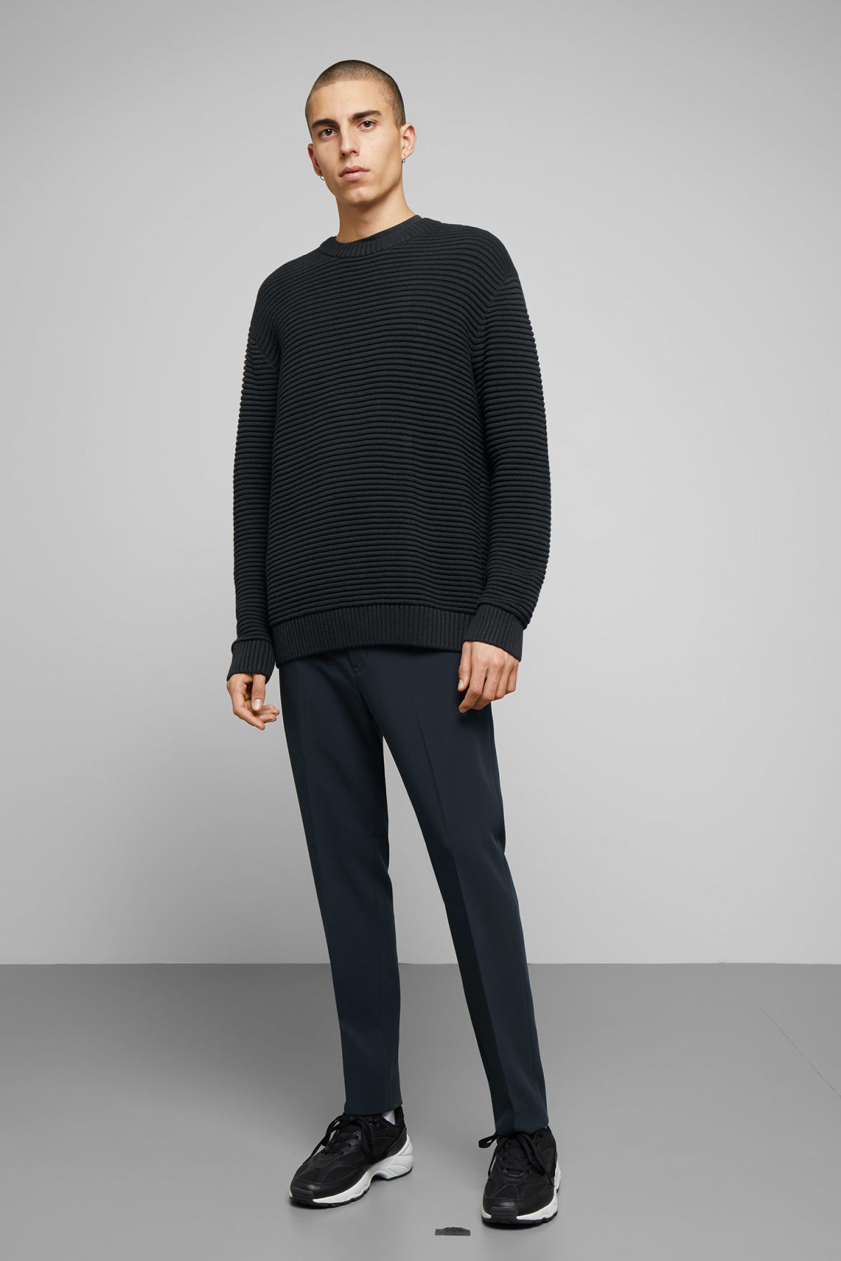 Model side image of Weekday smyth waffle sweater  in black