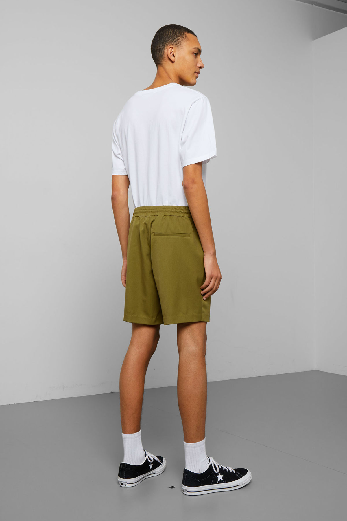 Model back image of Weekday alf shorts  in green