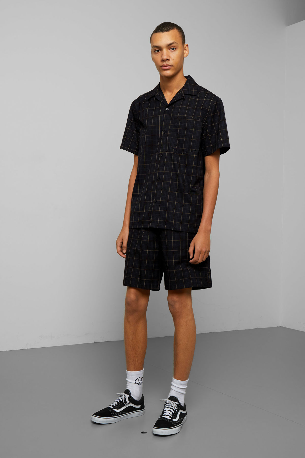 Model side image of Weekday osvald checked short sleeve shirt in black