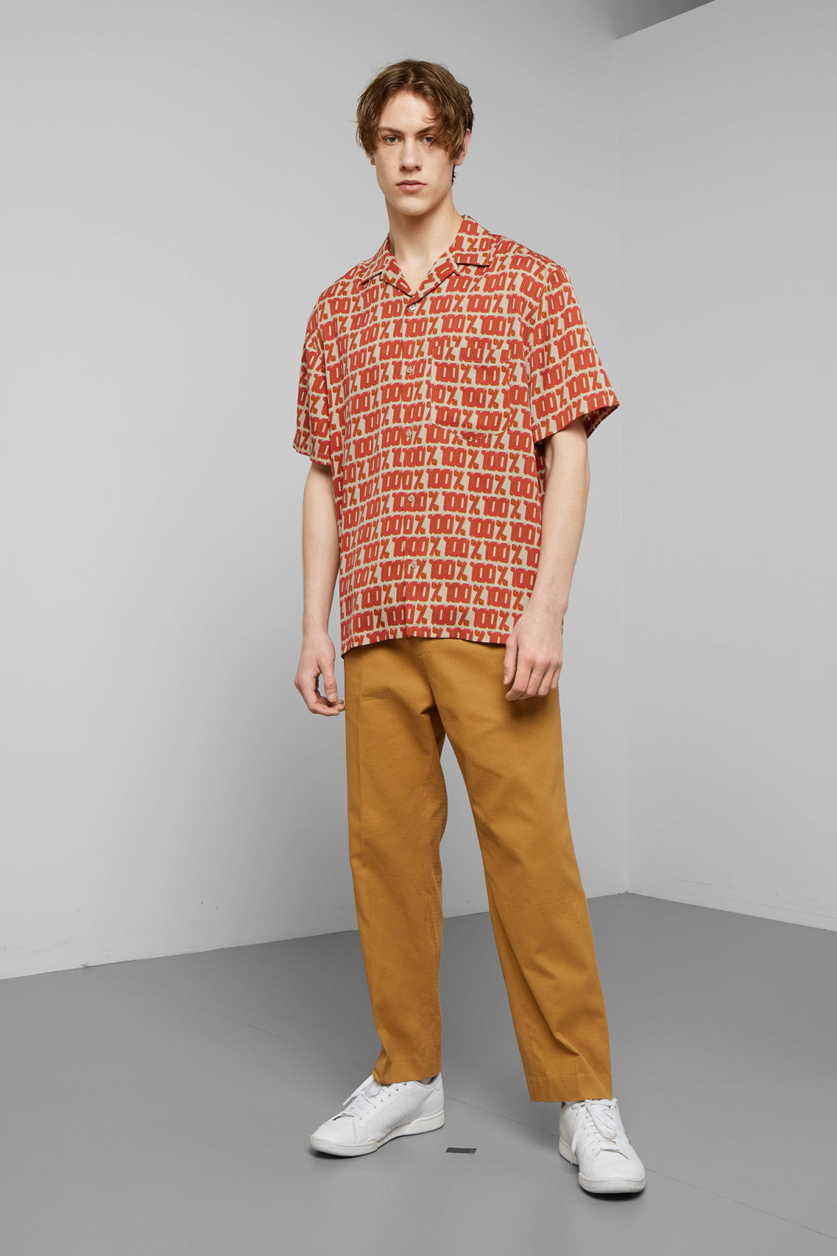 Model side image of Weekday skyway hundred short sleeve shirt in beige